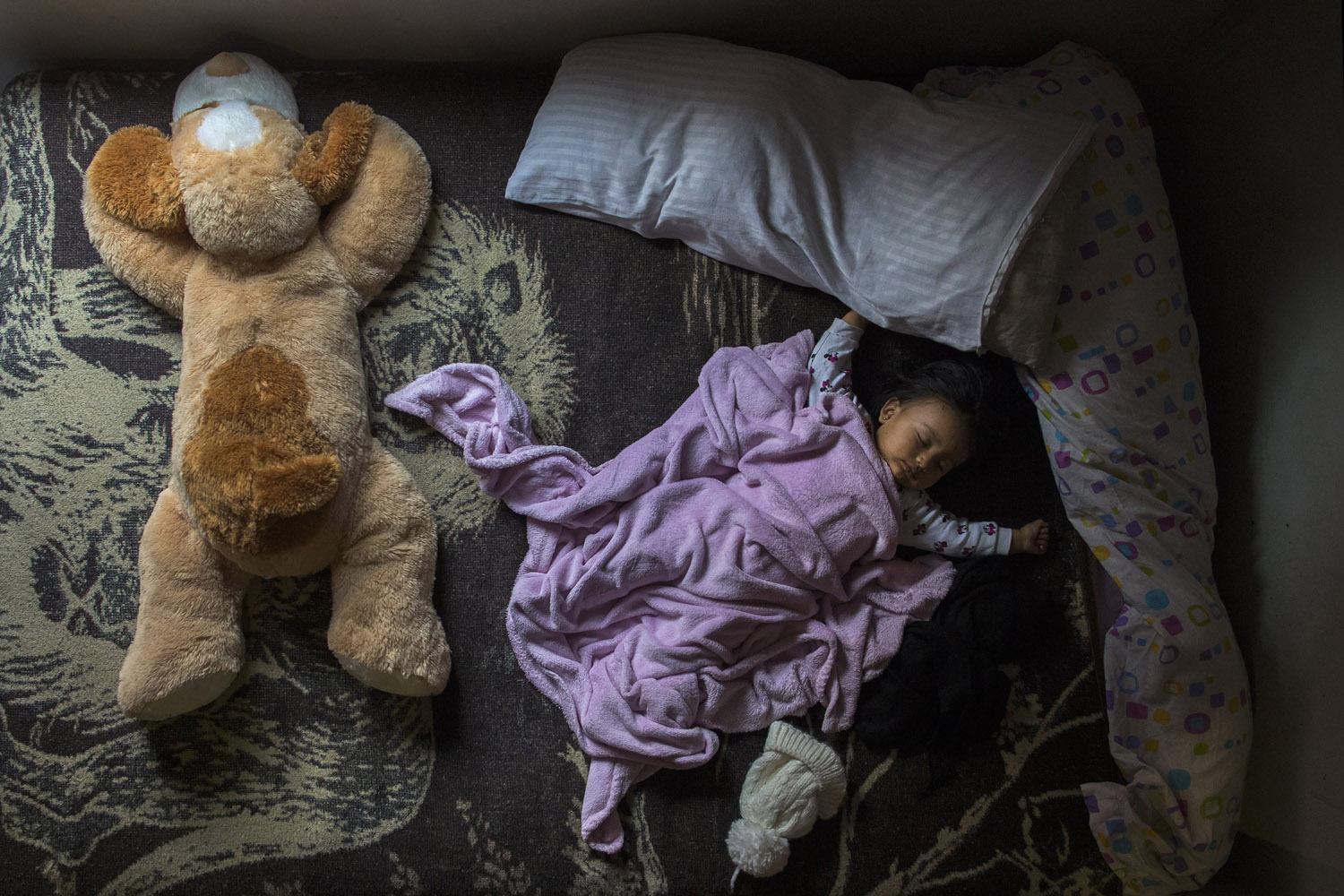 Mar. 21, 2014. 11 month - old Daniela Chasi Saavedra, as her family wait for the judicial commission and the police to arrive for their eviction, in Madrid, Spain.