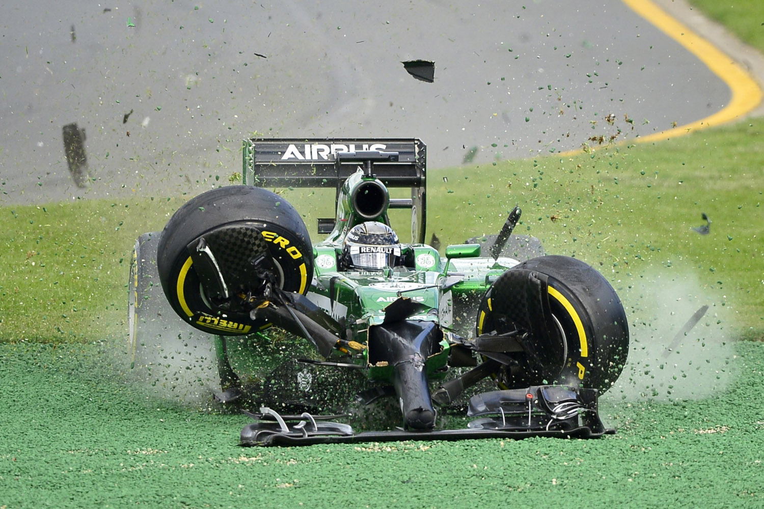 Mar. 16, 2014. Caterham driver Kamui Kobayashi of Japan runs off the track after he crashed with Williams driver Felipe Massa of Brazil on the first lap of the Australian Formula One Grand Prix at Albert Park in Melbourne, Australia.