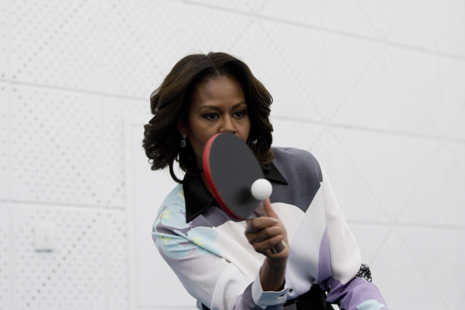 Mar. 21, 2014. US First Lady Michelle Obama plays table tennis as she visit to the Beijing Normal School, a school that prepares students to attend university abroad in Beijing, China.