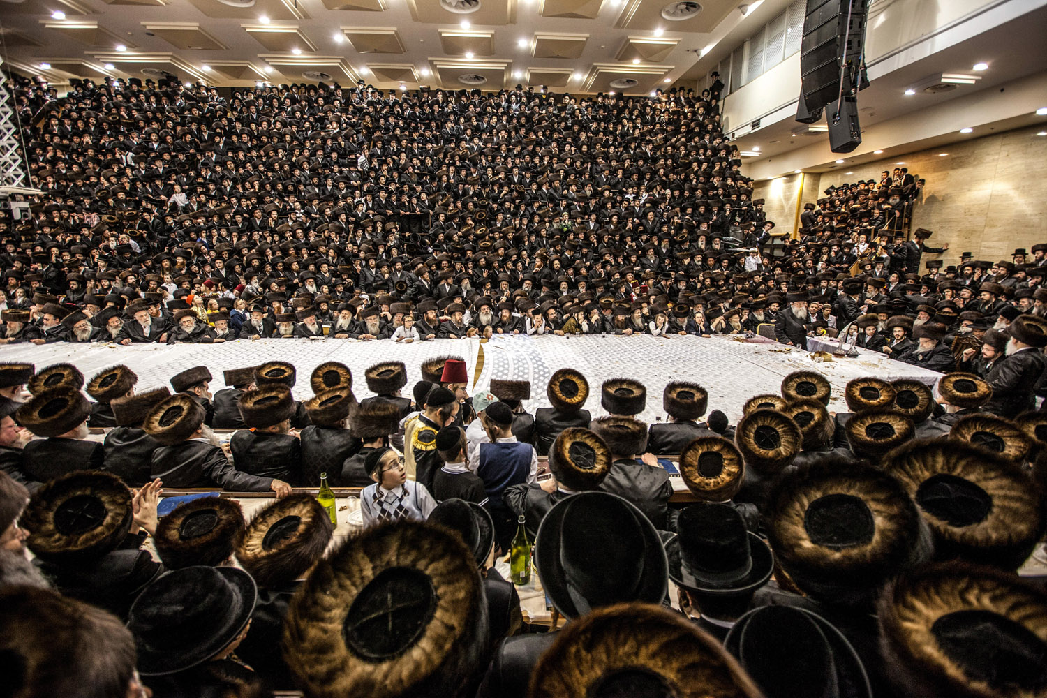 Mar. 17, 2014. Ultra Orthodox Jews from the Belz Hasidic group are taking part in a  Tisch , which is a public gathering of Hasidim around their Rabbi, during the Holiday celebration of Purim.