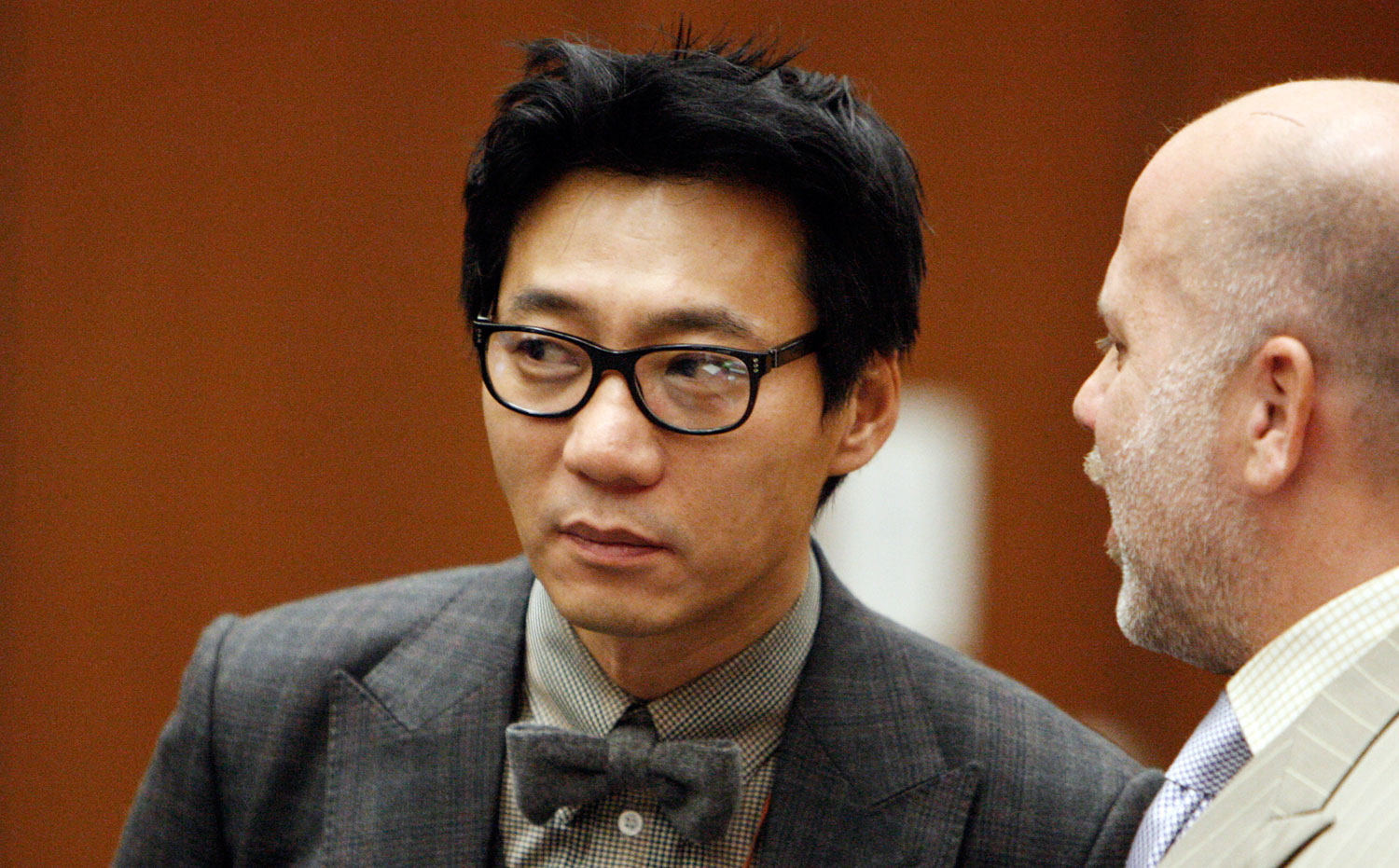 Young Lee stands with his attorney Philip Kent Cohen, right, during his arraignment in the Los Angeles Criminal Courts Building in Los Angeles in 2012.