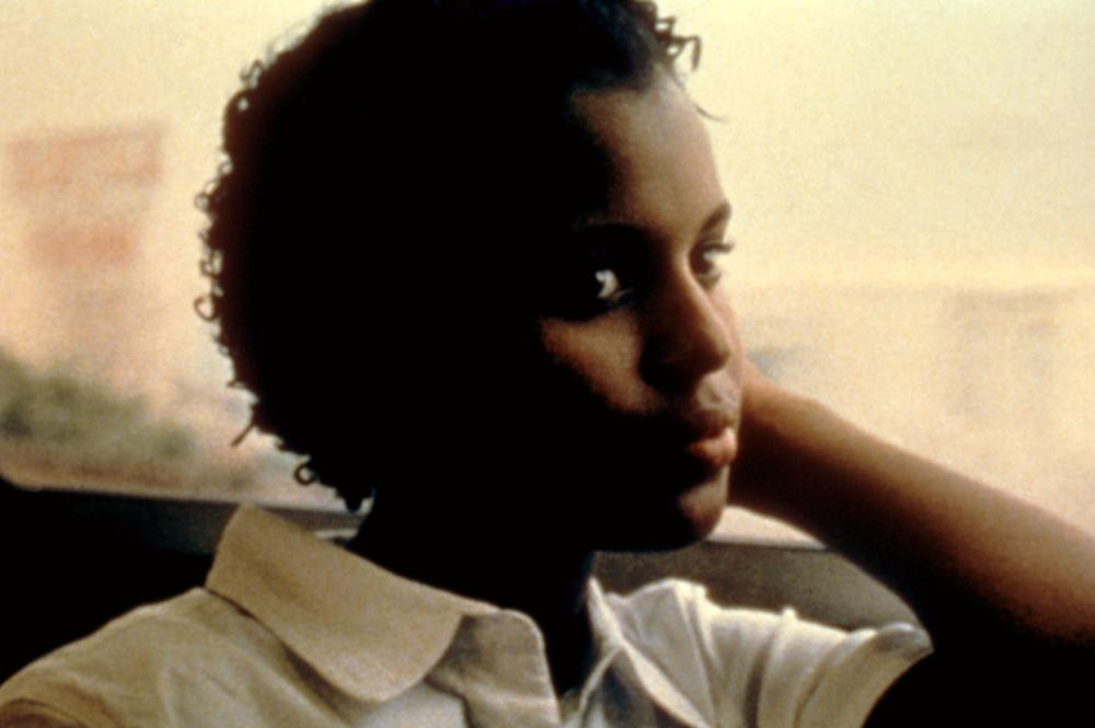 <b><i>Our Song</i>, 2000:</b> In her debut film role, Washington played Lanisha Brown, who—along with her two friends—is a member of the Jackie Robinson Steppers, a community marching band in Crown Heights. Over the summer, the girls must figure out where they will attend high school in the fall, after their current one shuts down.