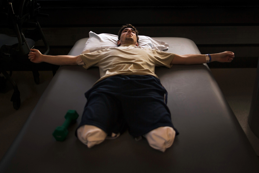 2014 Pulitzer Prize for Feature PhotographyJeff Bauman rests during occupational therapy at Spaulding Rehabilitation Hospital less than a month after having his lower legs blown off in the first of two pressure cooker bombs that exploded at the Boston Marathon, May 8, 2013.