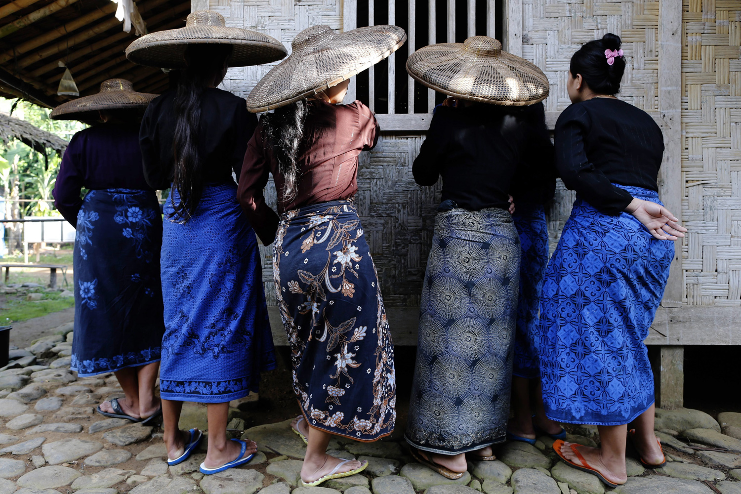 Apr. 9, 2014. Indonesian Baduy tribe women wait for their turn to cast their ballots during the parliamentary elections at a polling station in Kanekes village, Lebak, Banten province, Indonesia, Polls opened on 09 April in Indonesia's parliamentary elections amid expectations of an opposition victory.
