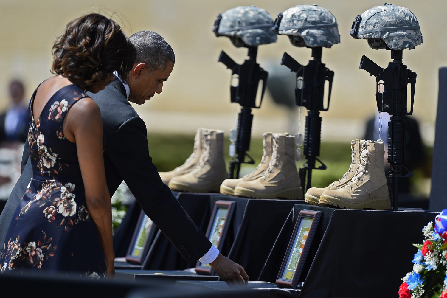 Arp. 9, 2014. President Barack Obama (2-L) first lady Michelle Obama (L) pay their last respects to three soldiers during a memorial service at Fort Hood military base near Killeen, Texas.