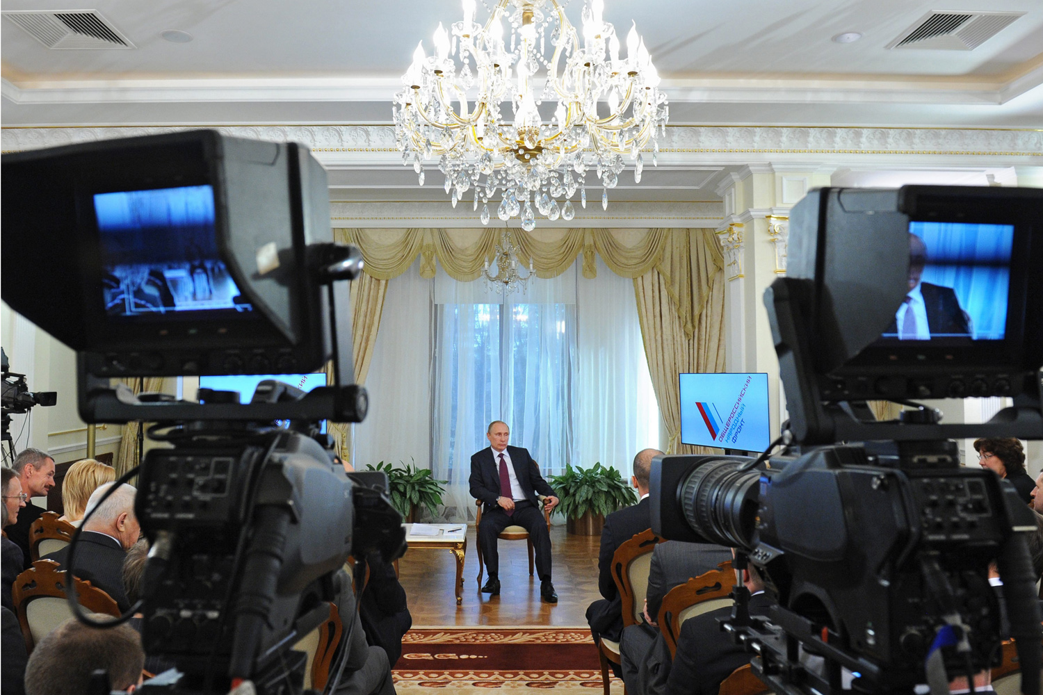 Apr. 10, 2014. Russian President Vladimir Putin speaks with All-Russia People's Front activists during their meeting in his Novo-Ogaryovo residence outside Moscow.