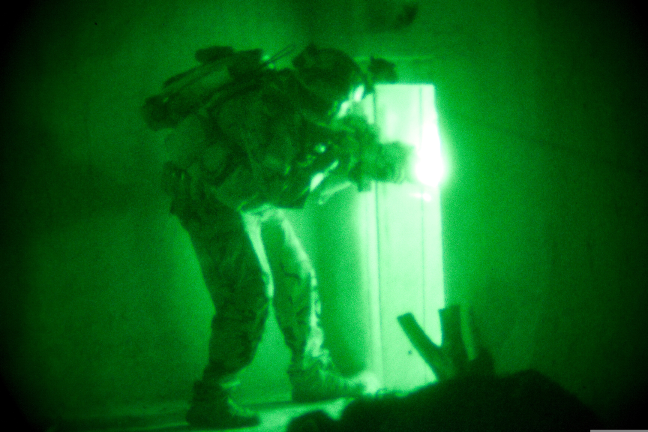 A U.S. Special Forces soldier hunting for Taliban inside a compound in Wardak province, Afghanistan.