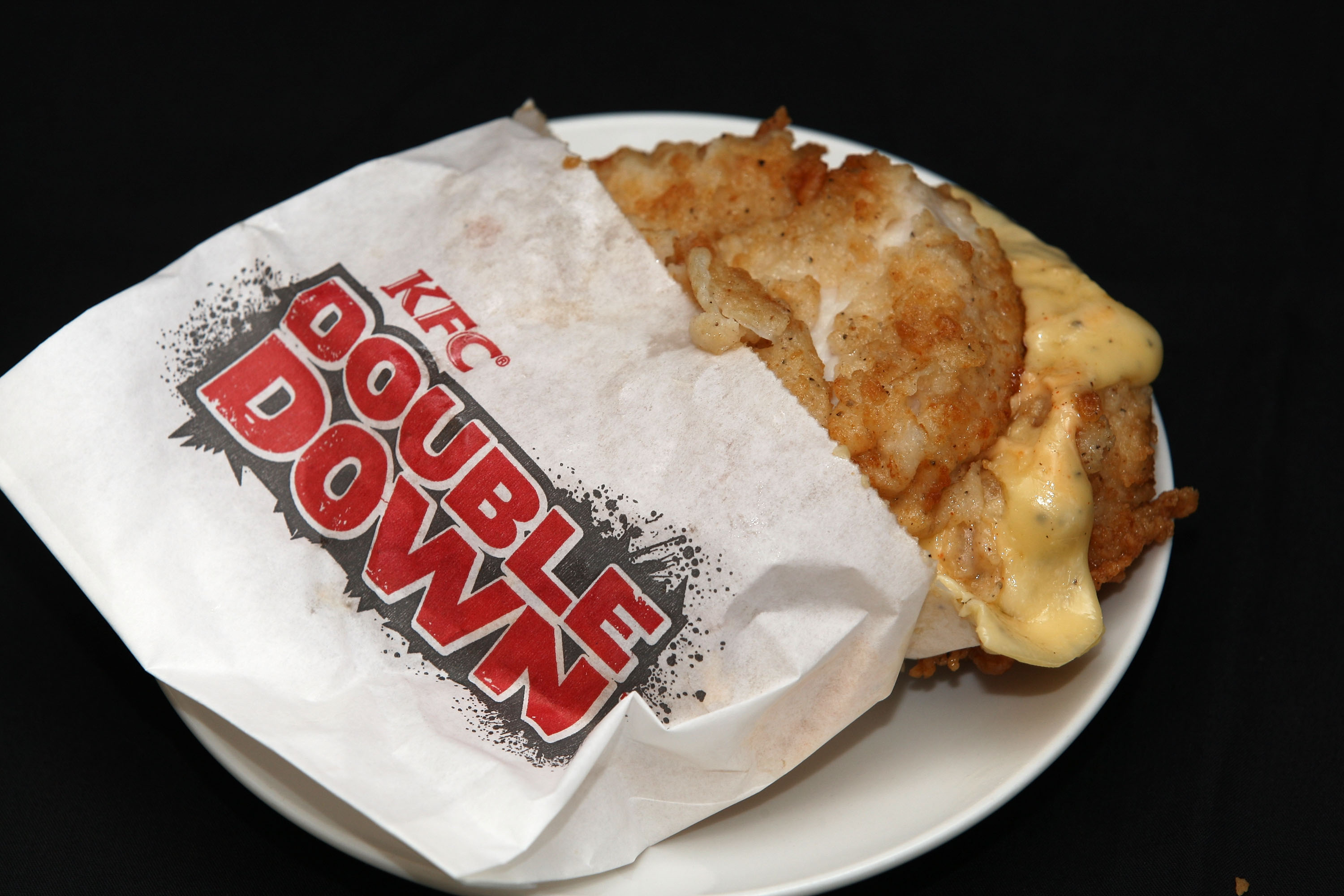 XXX YYY at XXX on May 10, 2011 in Auckland, New Zealand. The KFC 'Double Down' is a 604-calorie 'bunless' burger that consists of two strips of bacon, cheese and 'special sauce' served between two KFC chicken fillets and has been a hot topic after being condemned by nutritionists concerned with the high calorie and saturated fat content.