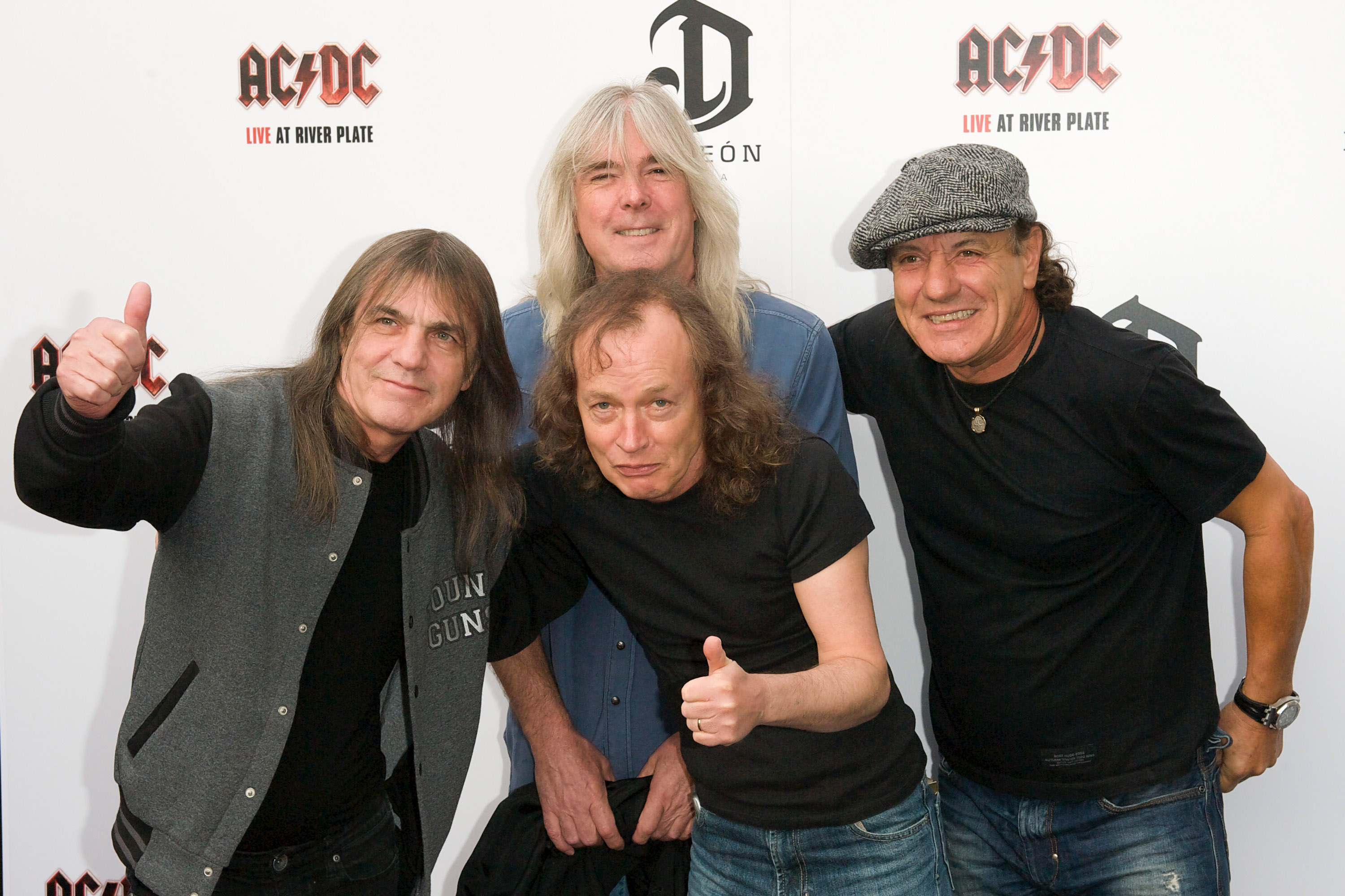 From left to right: AC/DC band members Malcolm Young, Cliff Williams, Angus Young and Brian Johnson attend the Exclusive World Premiere Of AC/DC  Live At River Plate  Presented By DeLeon Tequila at the HMV Apolo on May 6, 2011 in London, England.
