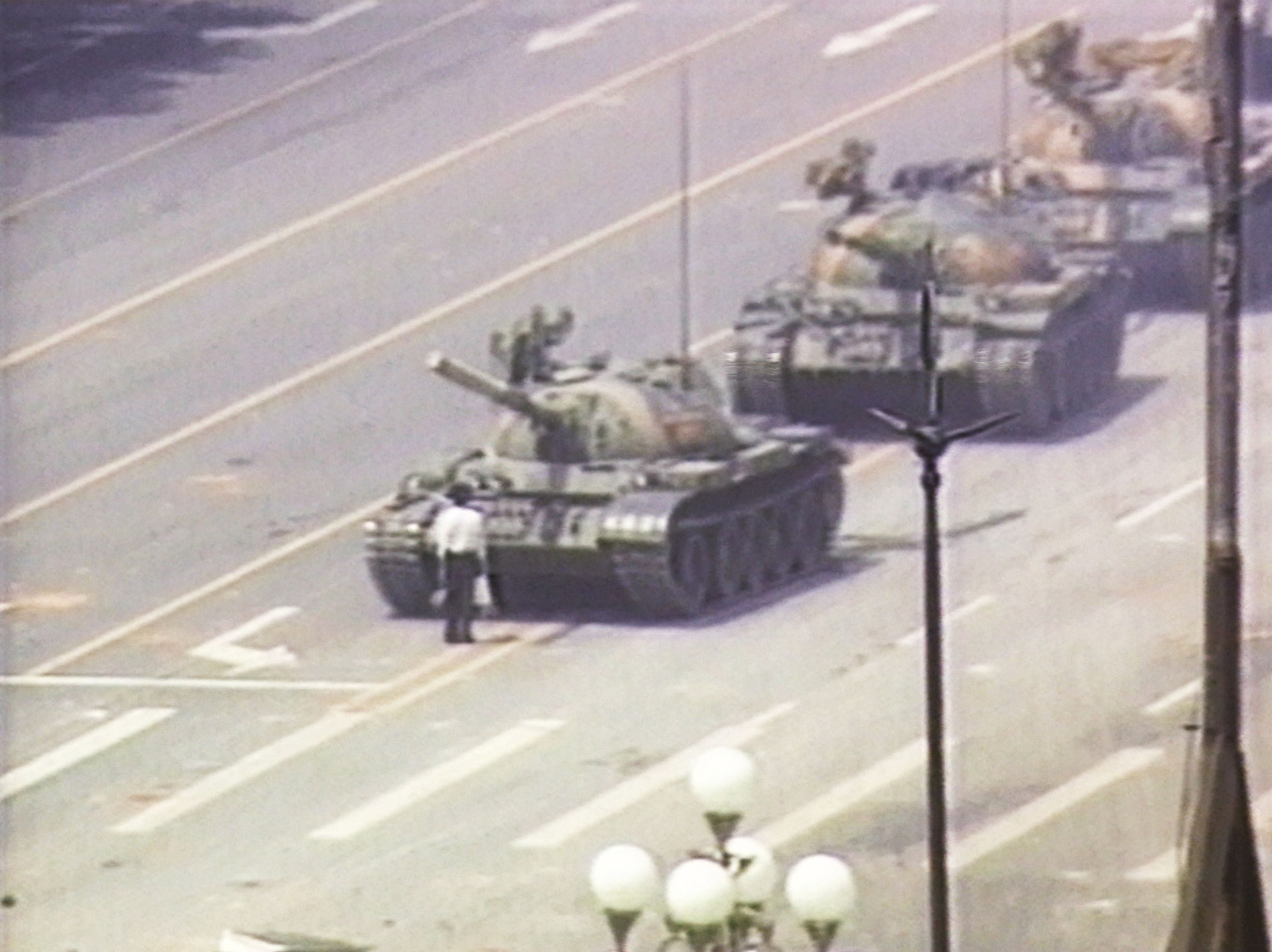 A lone demonstrator stands down a column of tanks June 5, 1989, at the entrance to Tiananmen Square in Beijing. The incident took place on the morning after Chinese troops fired on pro-democracy students who had been protesting in the square since April 15, 1989