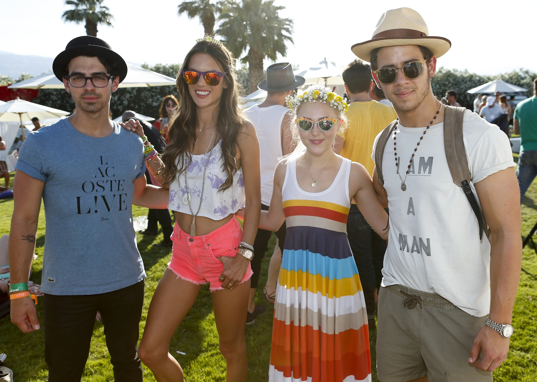 Musician Joe Jonas, model Alessandra Ambrosio, actress AnnaSophia Robb, and musician Nick Jonas attend the FIJI Water At Lacoste L!VE Coachella Desert Pool Party on April 13, 2013 in Palm Springs, Calif.