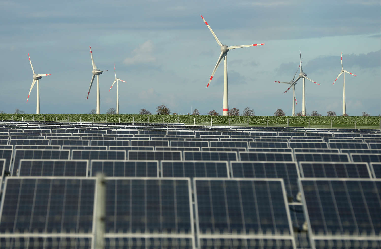 Investment in renewables like solar and wind is down, but their share of global power is up