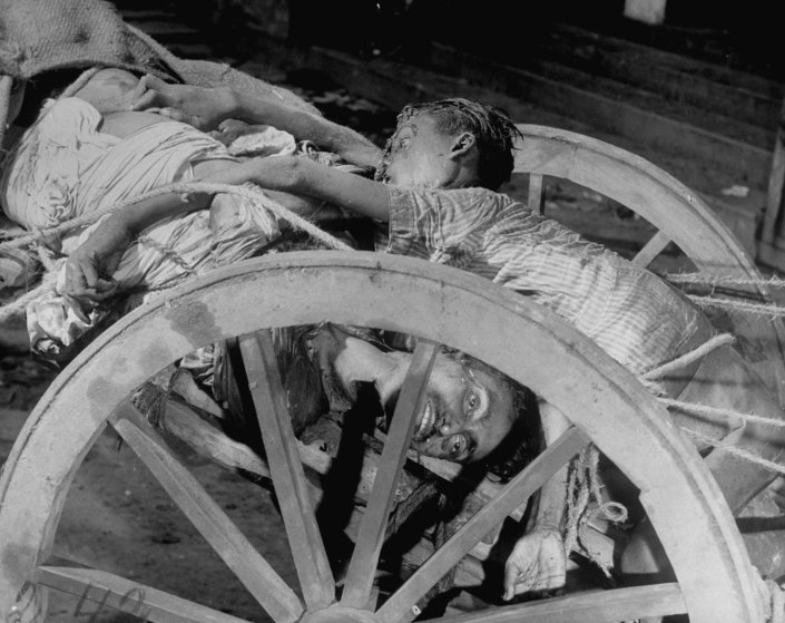 Corpses in a cart prior to being cremated after bloody rioting between Hindus and Muslims, Calcutta (now Kolkata), India, 1946.