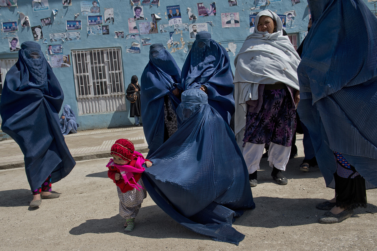 Afghan women leave a rally for Presidential candidate Zalmai Rassoul and Vice Presidential candidate Habiba Sarabi in Mazar-i-Sharif, Afghanistan, March 27, 2014.