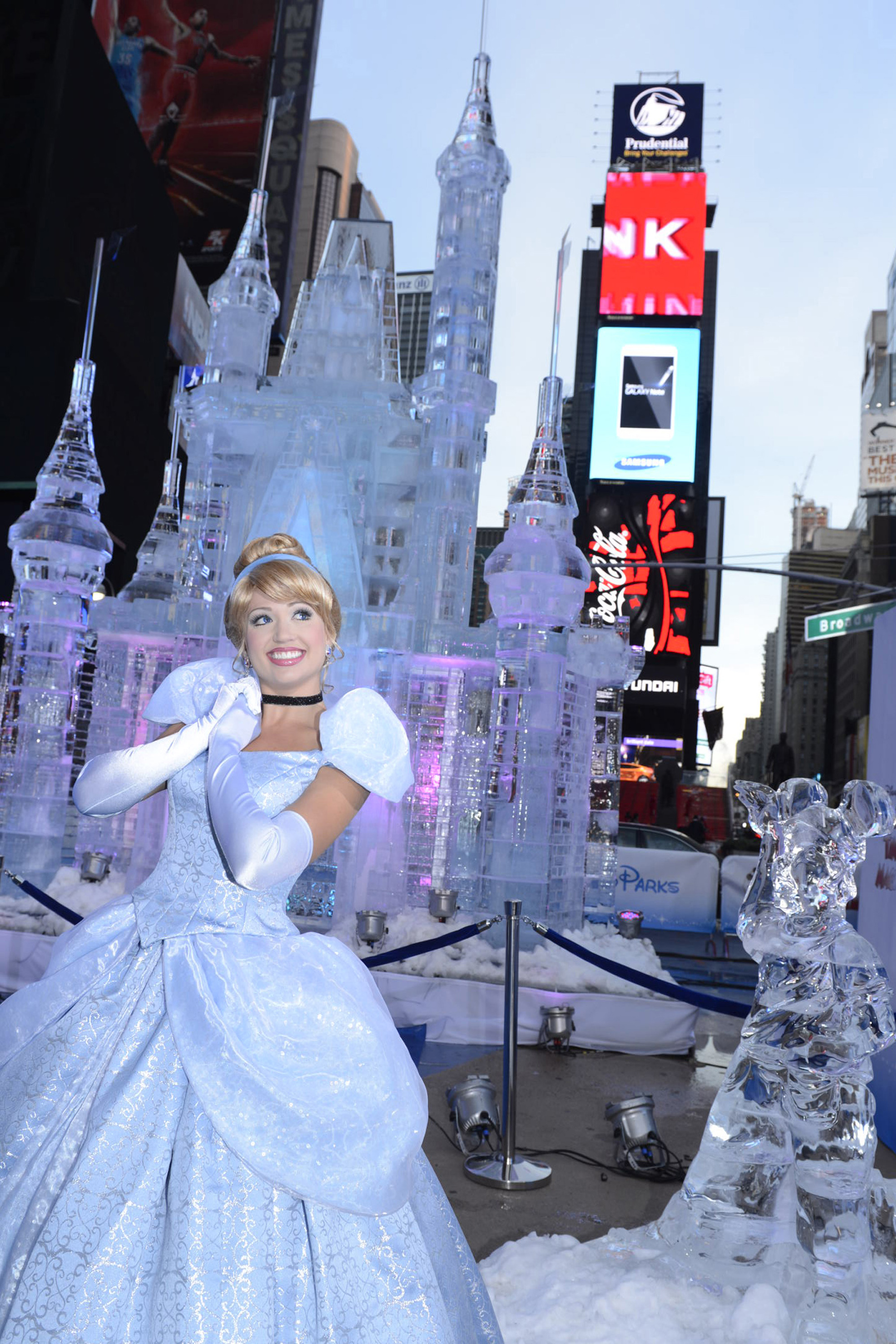 Disney Princess Cinderella poses Oct. 17, 2012 in front of a 25-foot-tall ice castle sculpture in Times Square in New York City.   ( David Roark/Disney Parks via Getty Images)