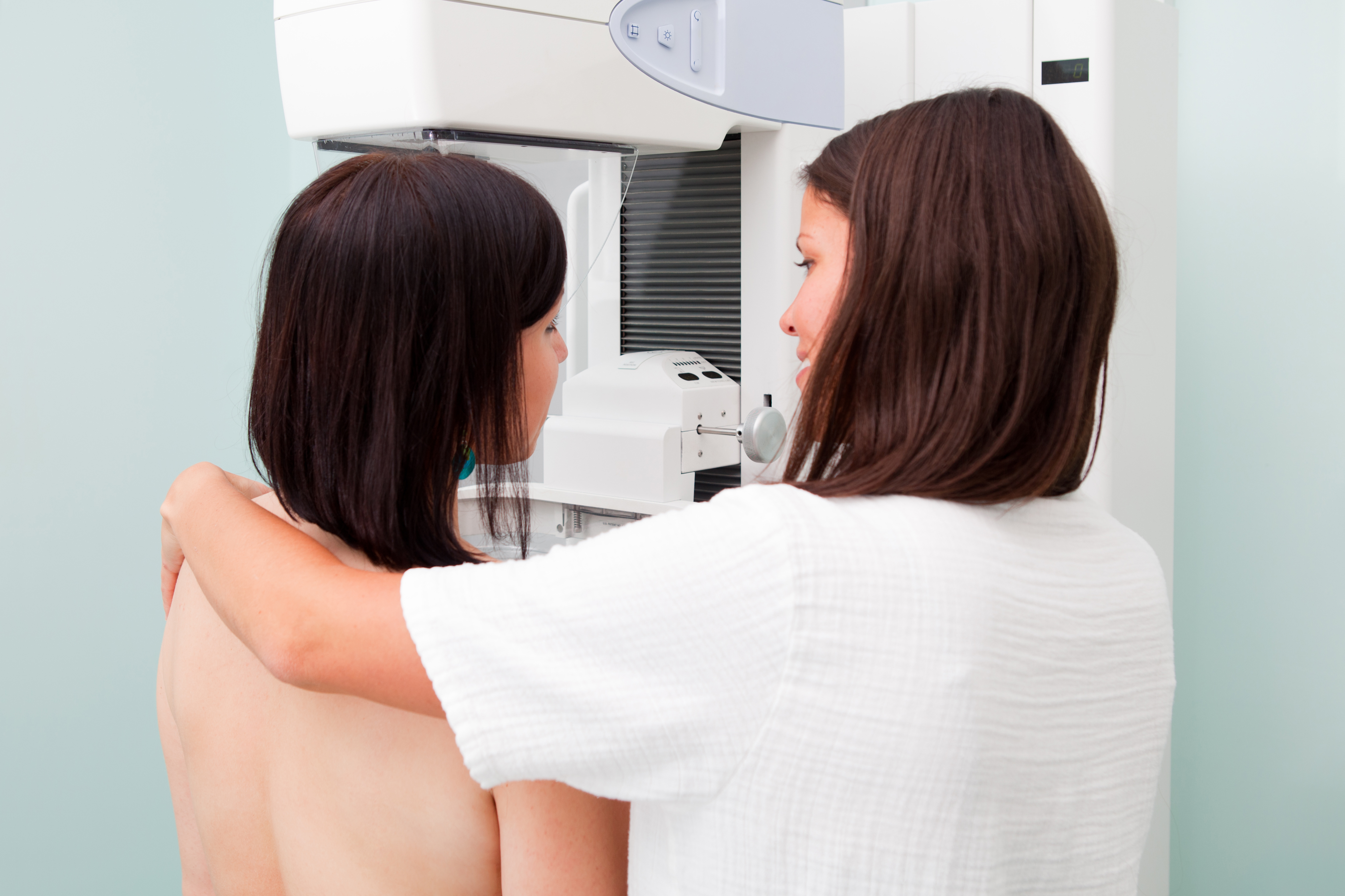 Nurse with patient having a mammogram.