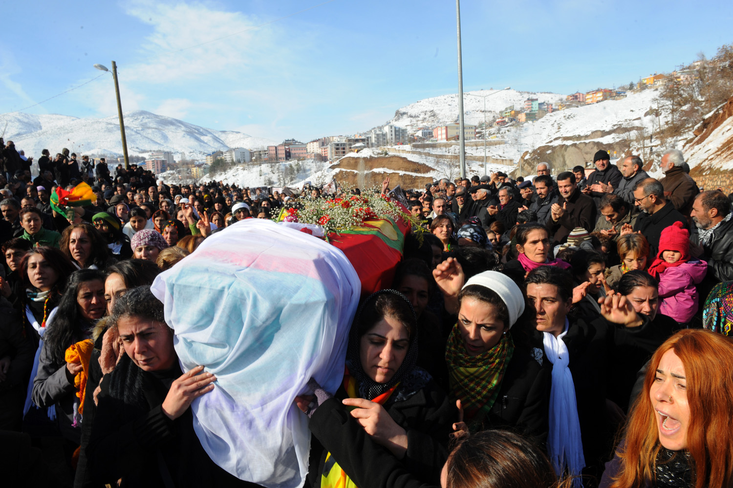 People gather in Tunceli, Turkey, Jan. 18, 2013  to pay a final tribute to Kurdish activist Sakine Cansiz who was assassinated in Paris.