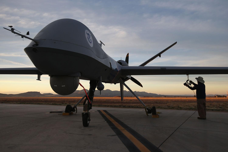 Maintenence personel check a Predator drone on March 7, 2013 in Sierra Vista, Arizona.
