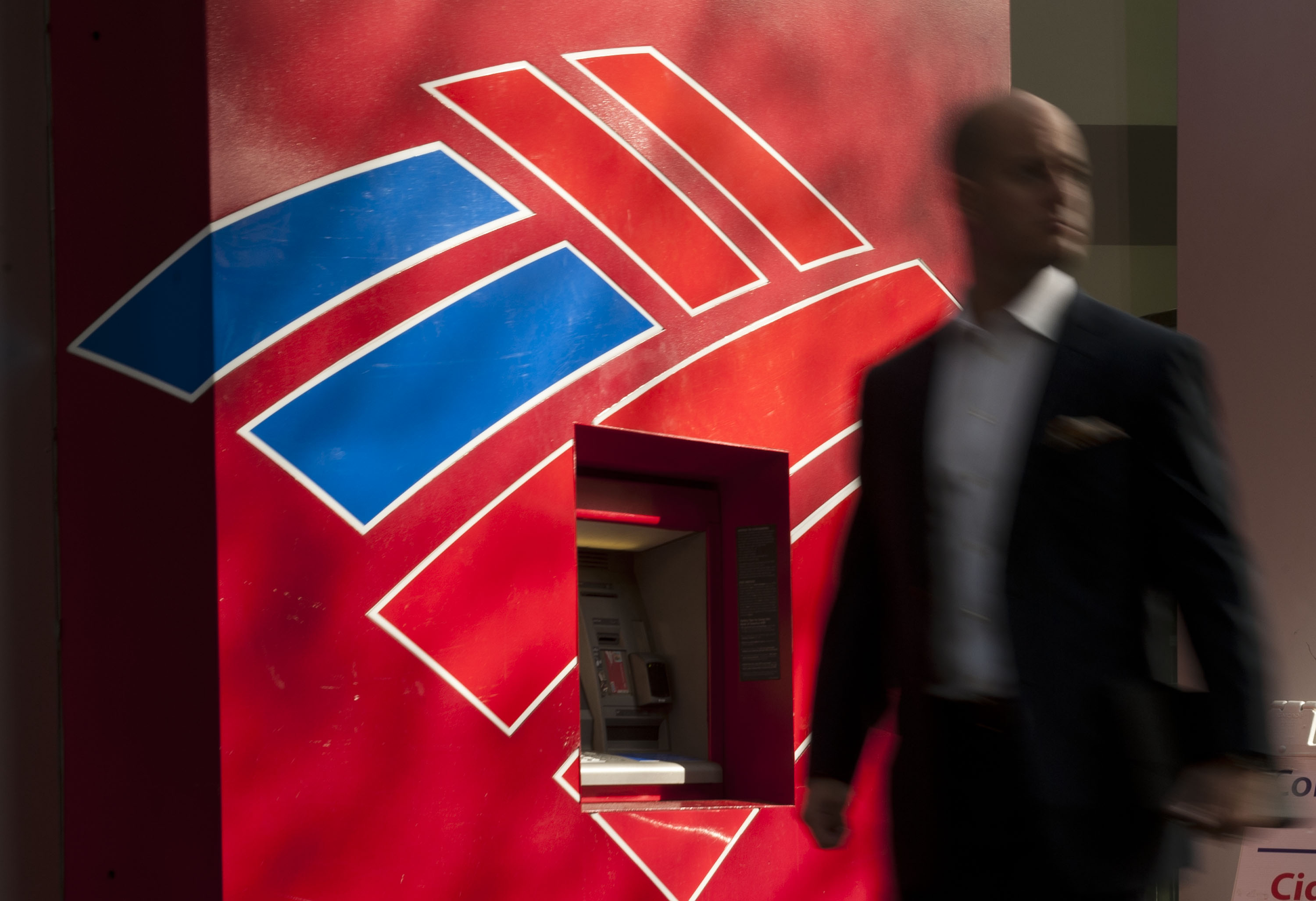 A man walks past a Bank of America ATM in Charlotte, N.C., May 8, 2013.
