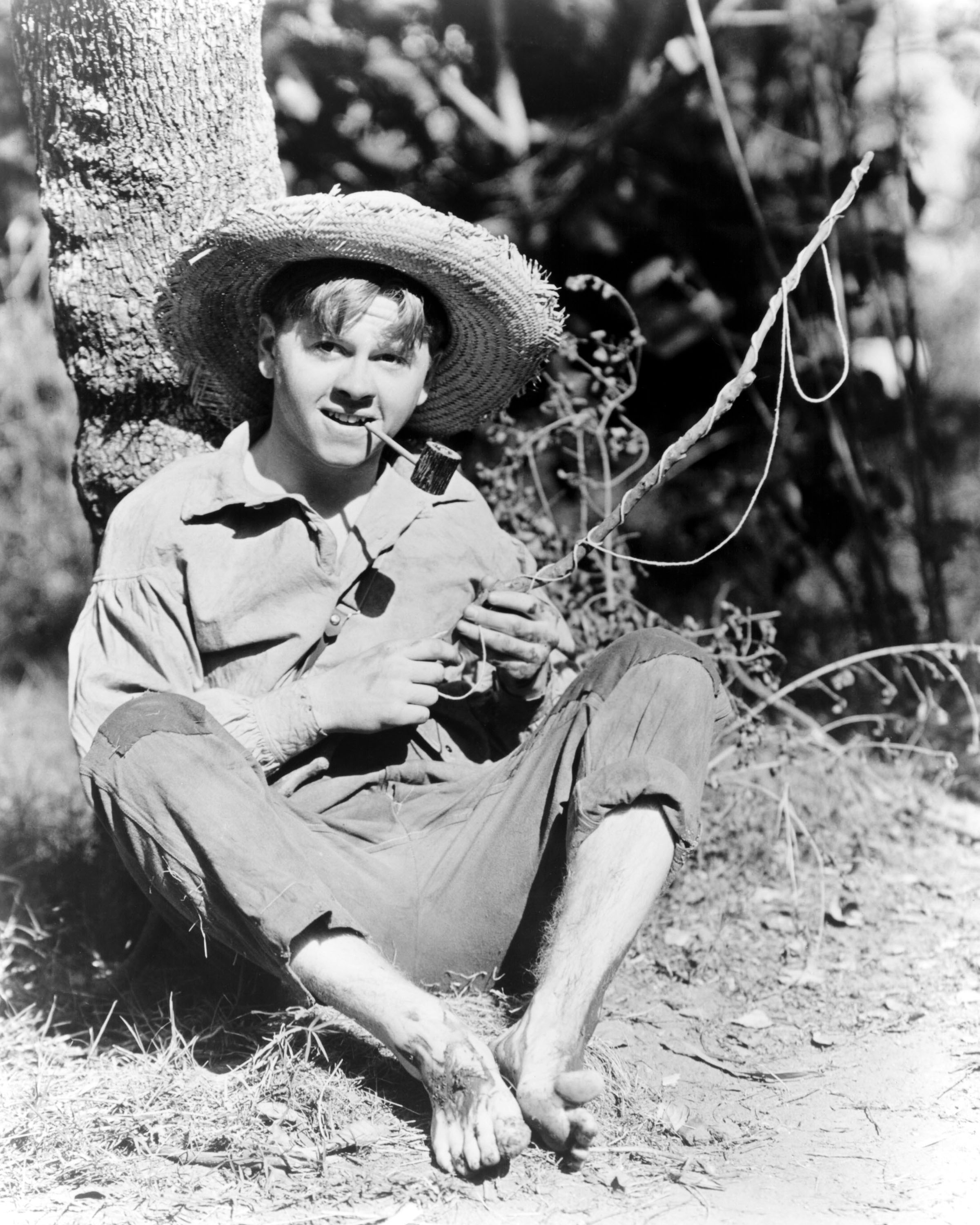 Rooney, as Huckleberry Finn, in <i>The Adventures of Huckleberry Finn</i>, directed by Richard Thorpe, in 1939.