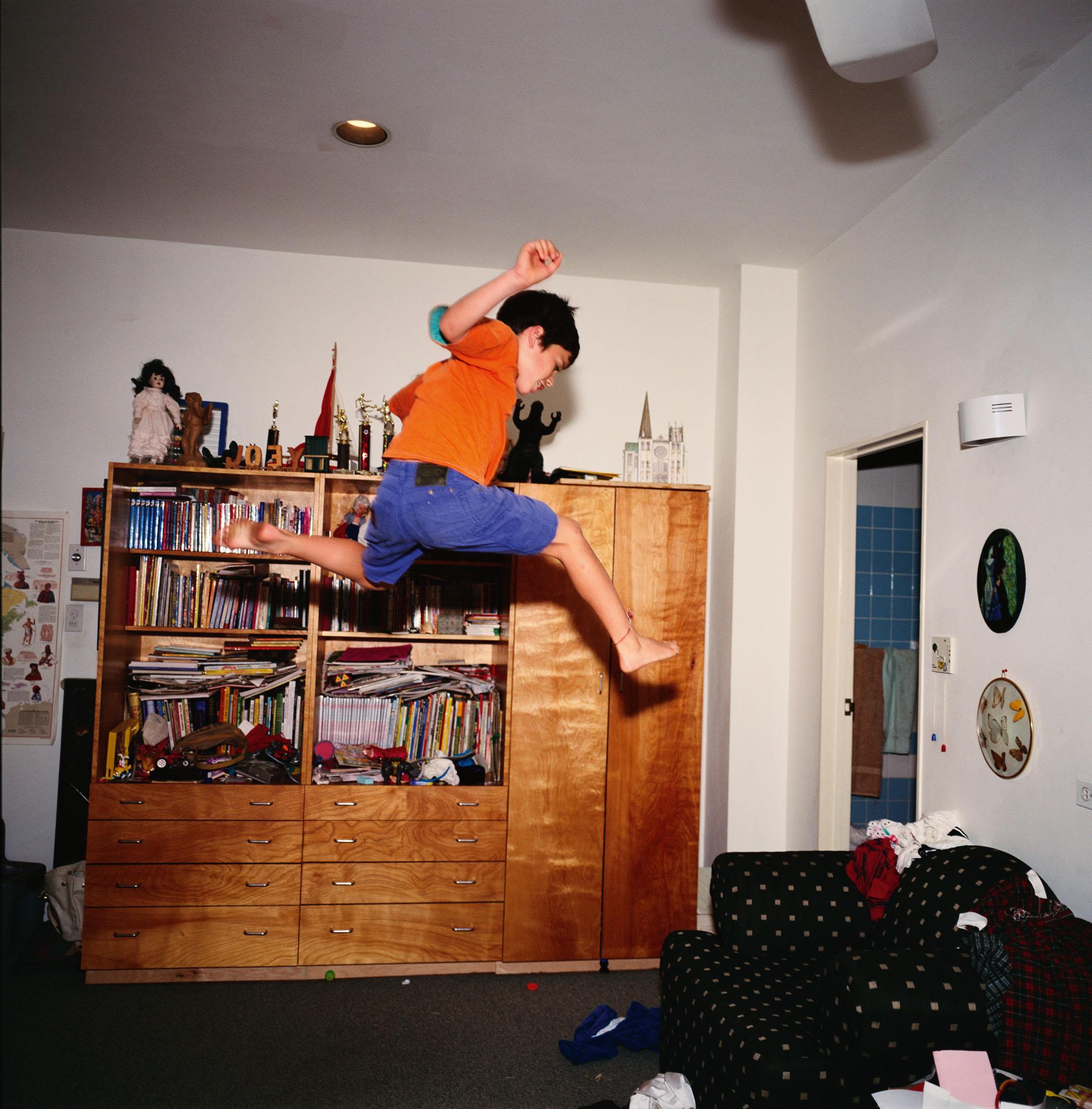 Joe flying across his room, NYC, 1994