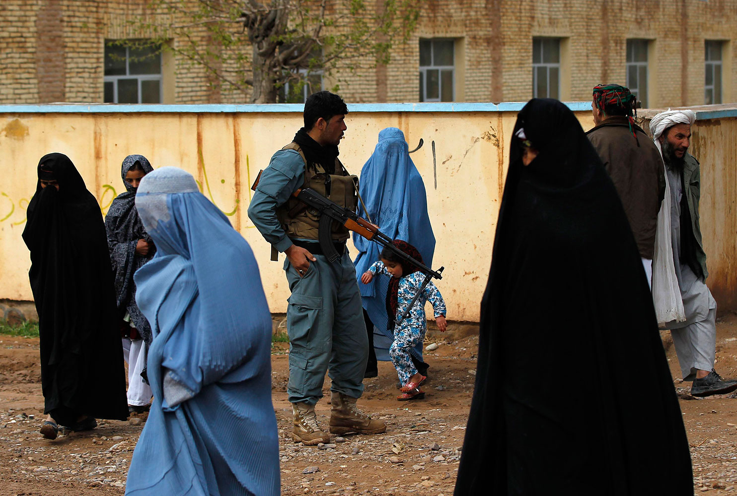 Afghan women arrive to vote at a polling station in Adraskan district, Herat province.