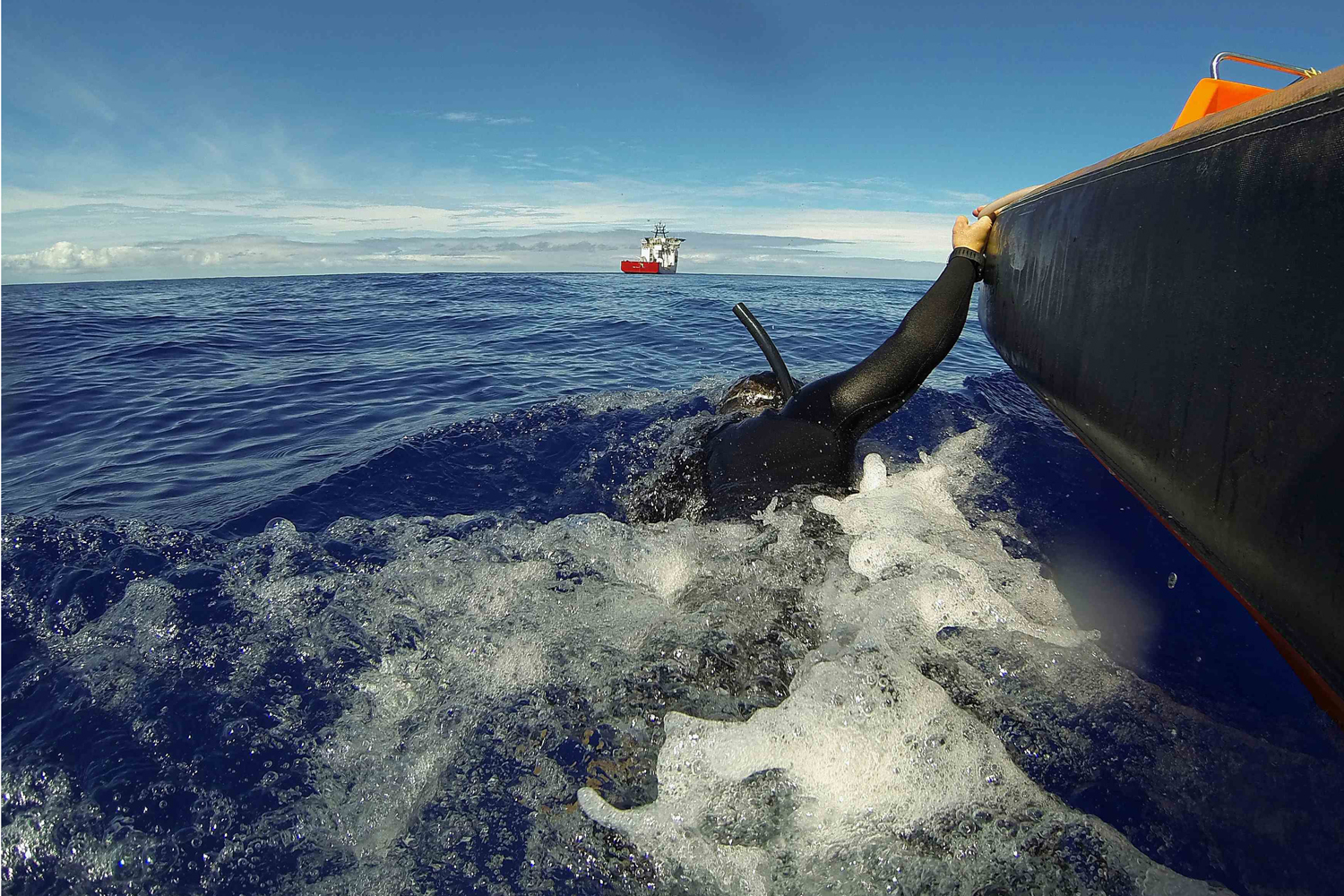 Apr. 8, 2014. A fast response craft from Australian Defense Vessel Ocean Shield tows Able Seaman Clearance Diver Michael Arnold as he searches the ocean for debris in the search zone in the southern Indian Ocean for the missing Malaysian Airlines flight MH370.