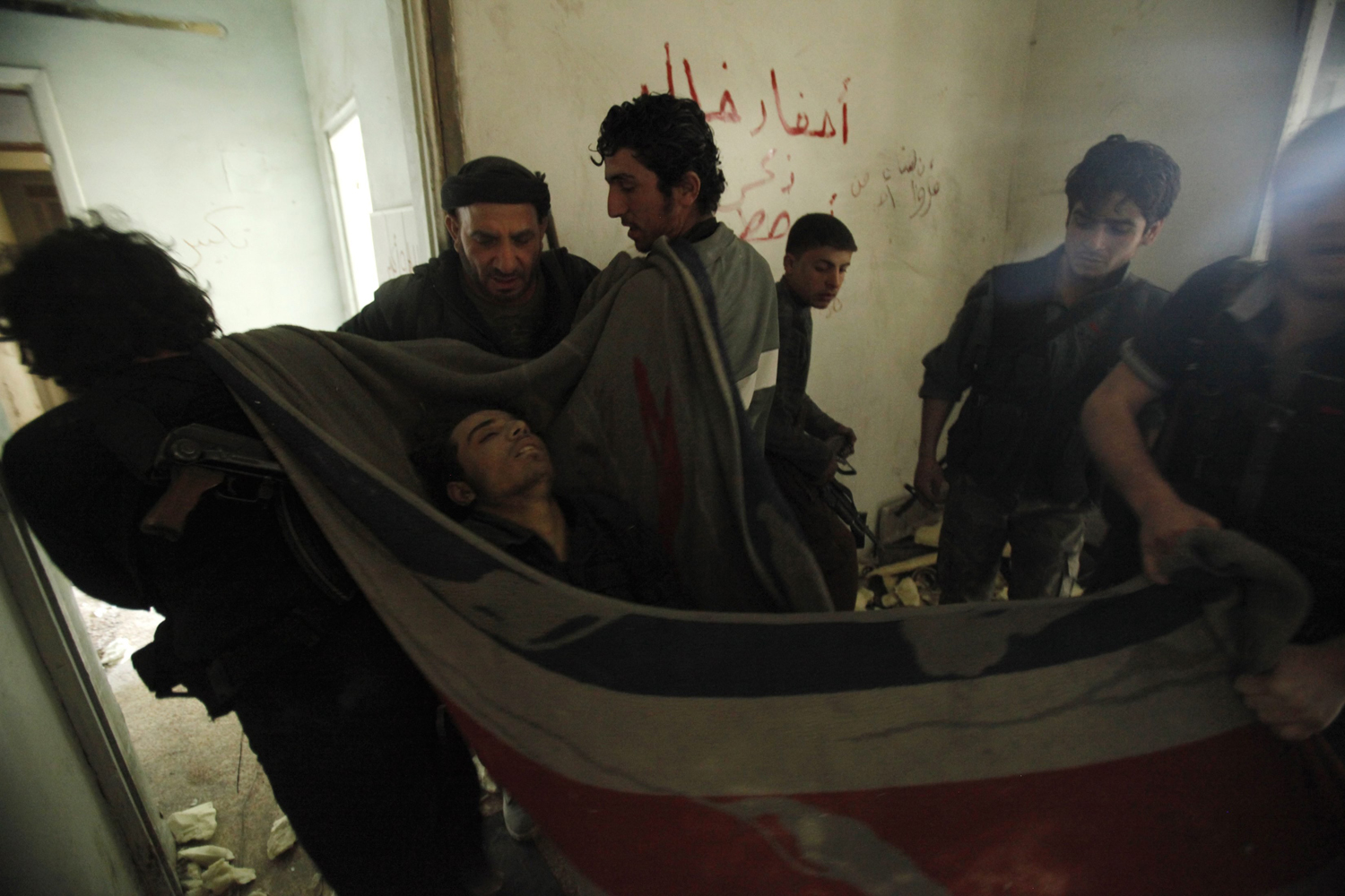 Apr. 9, 2014. Rebel fighters carry the body of a fellow fighter who was killed during what they said was an offensive against forces loyal to Syria's President Bashar al-Assad in the al-Amriyeh neighbourhood of Syria's northwestern city of Aleppo.