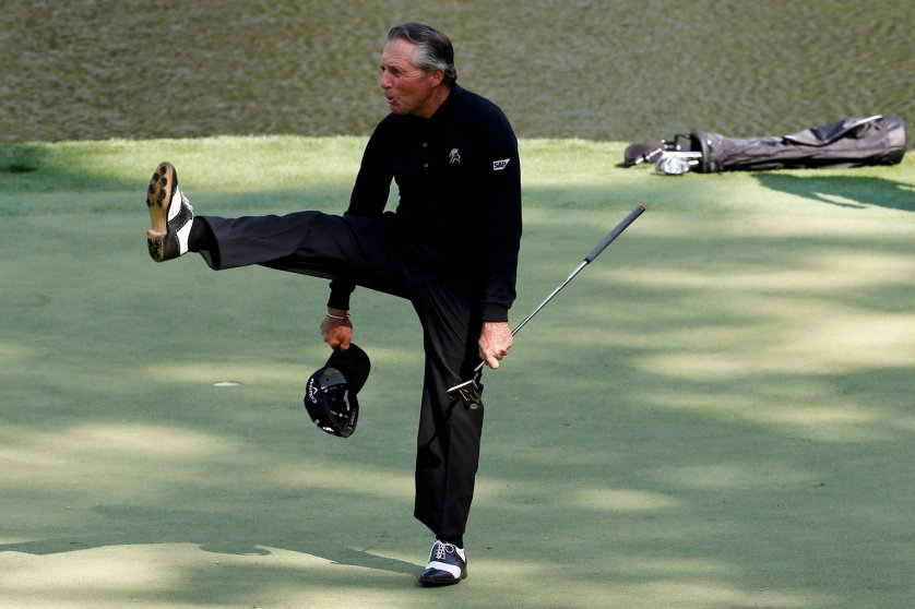 Former Masters champion Gary Player of South Africa reacts after a putt on the ninth hole during the Par 3 Contest at the Augusta National Golf Club in Augusta