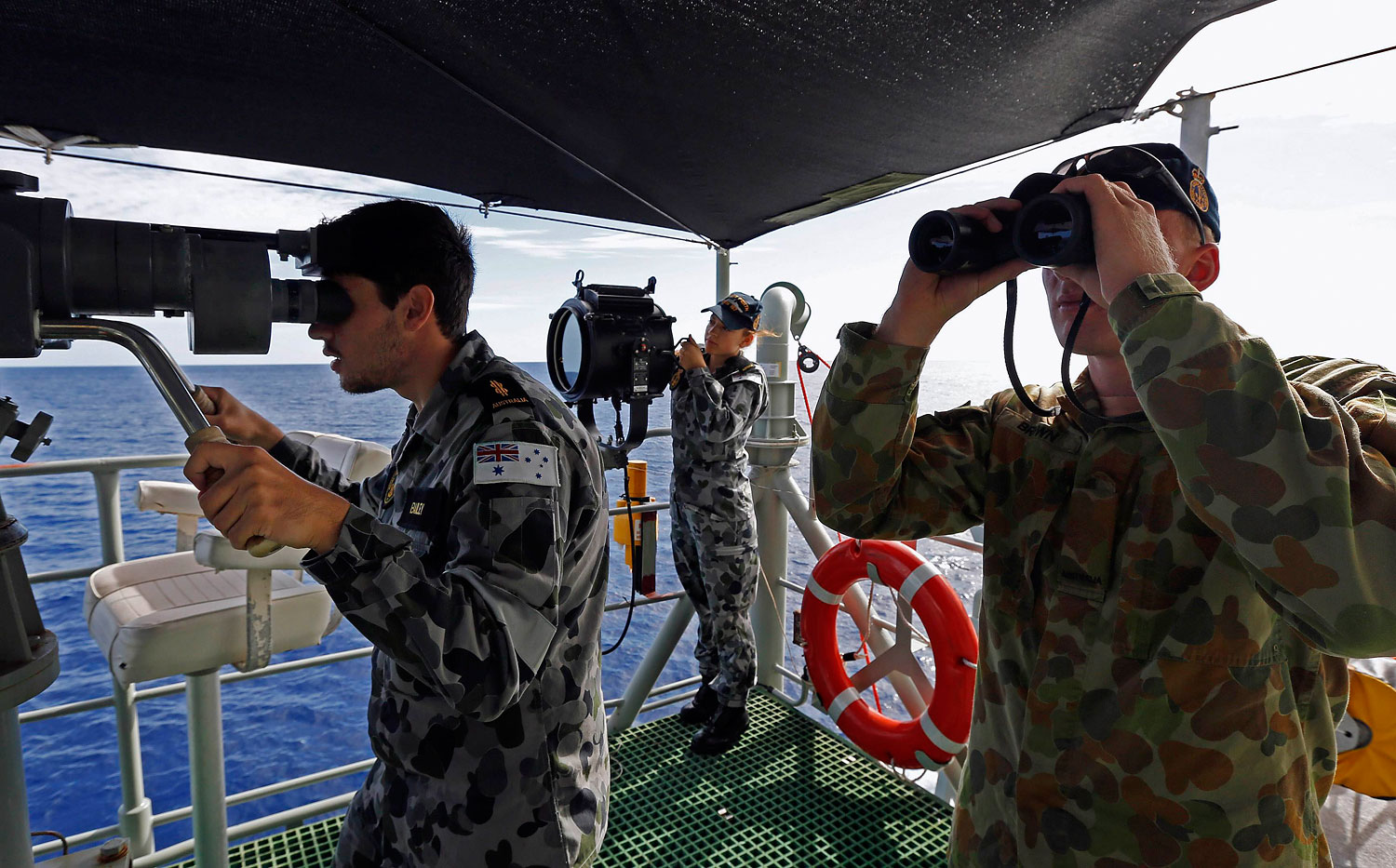 Crew members of the Australian navy ship H.M.A.S. Perth join the search for the missing Malaysian Airlines Flight MH370