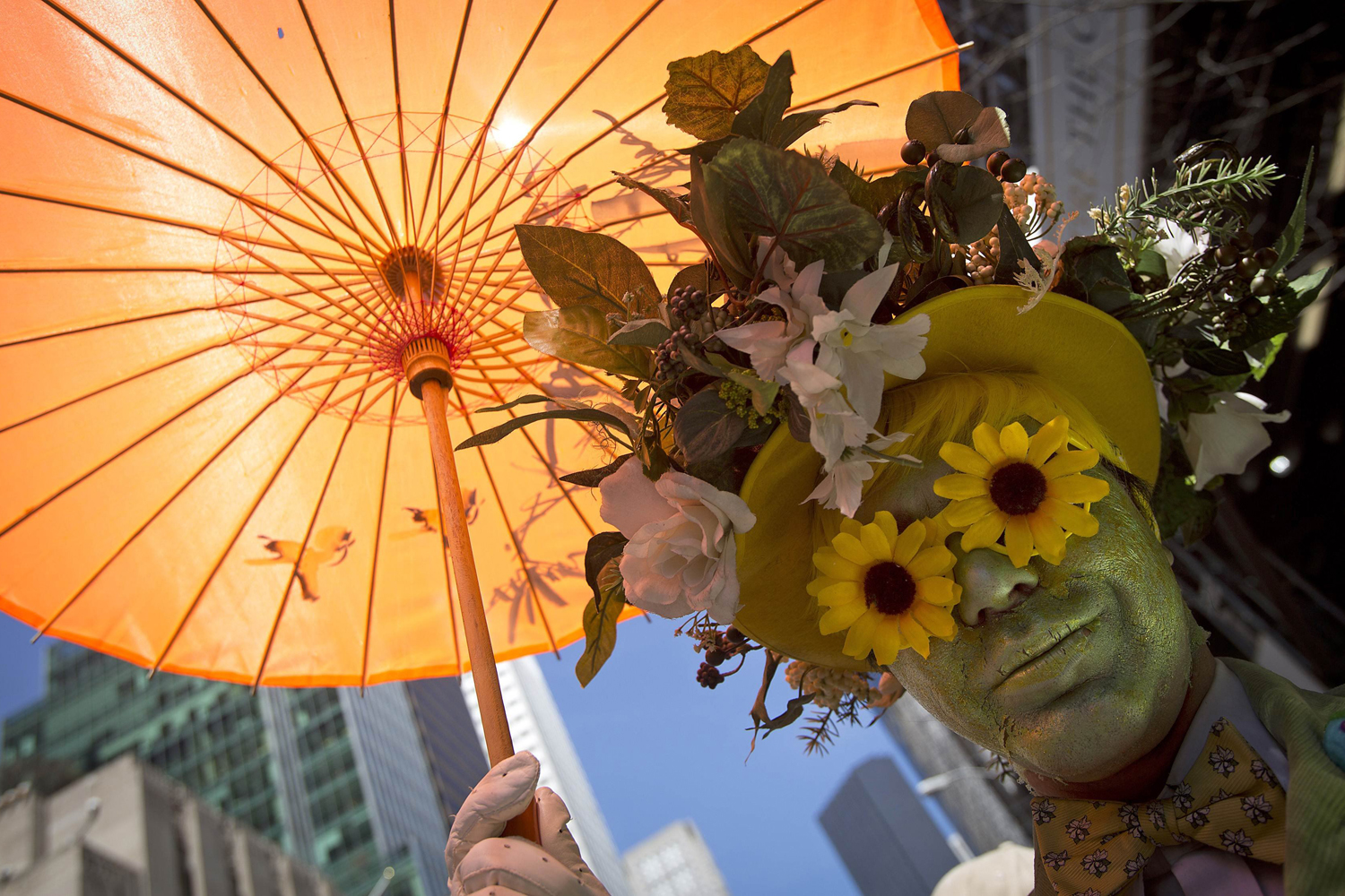 A participant dressed in costume holds an umbrella at the annual Easter Bonnet Parade in New York April 20, 2014.