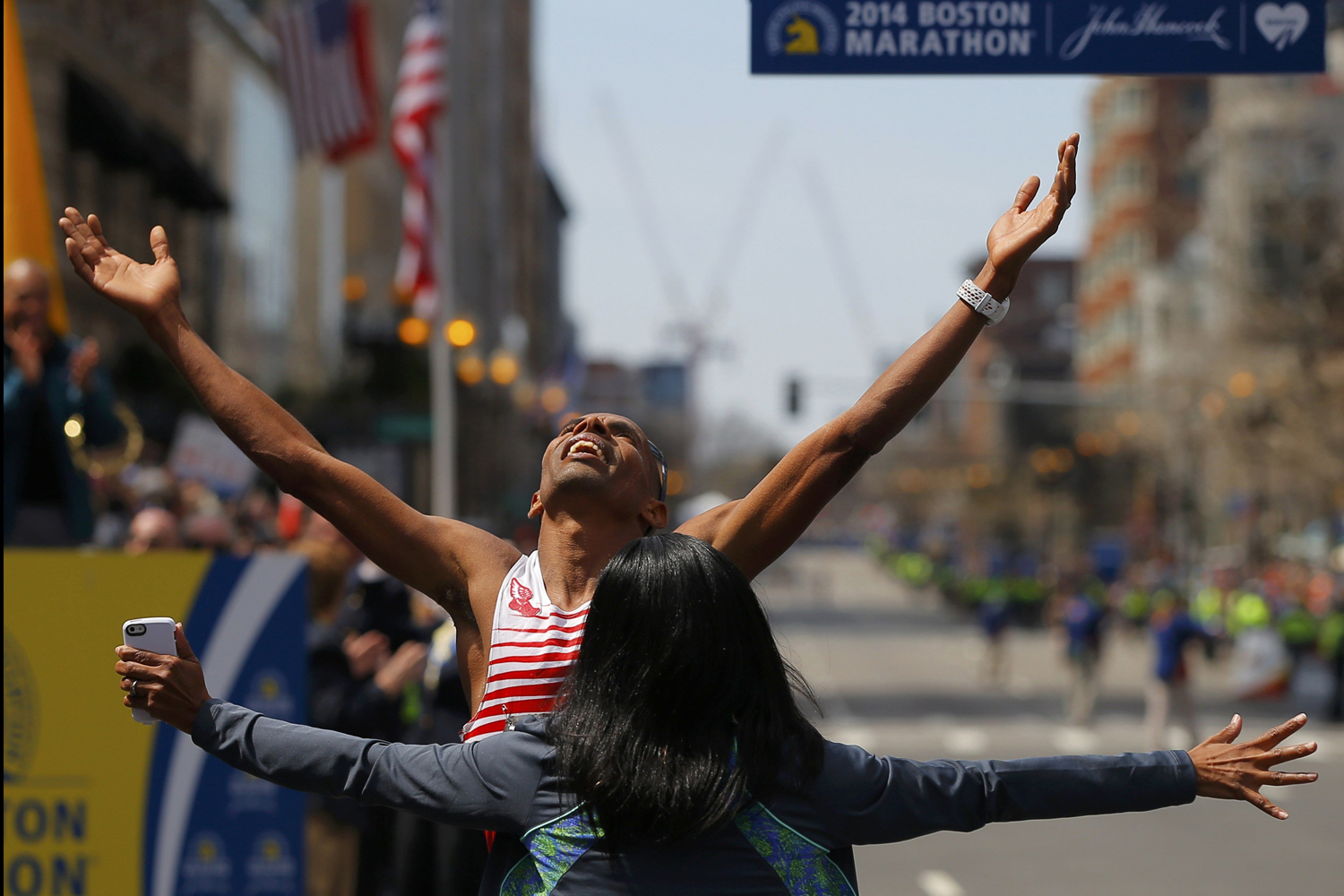 Meb Keflezighi of the U.S. celebrates with his wife Yordanos Asgedom after winning the men's division of the 118th running of the Boston Marathon on April 21, 2014.