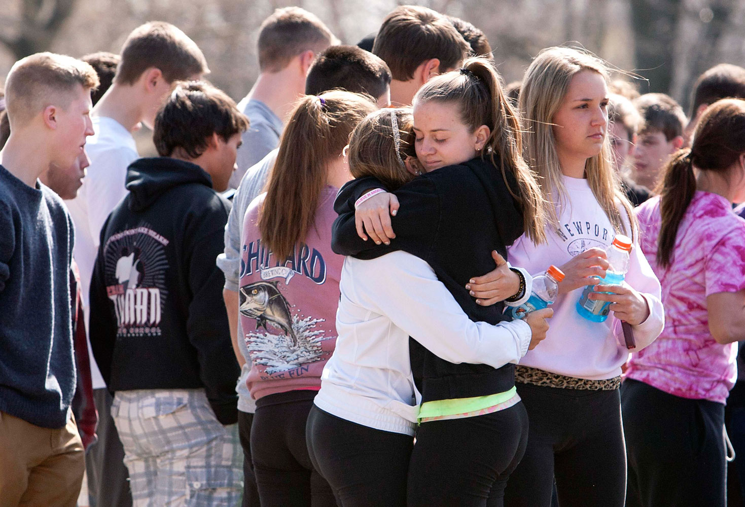 Students mourn in front of Jonathan Law High School in Milford, Conn. April 25, 2014.