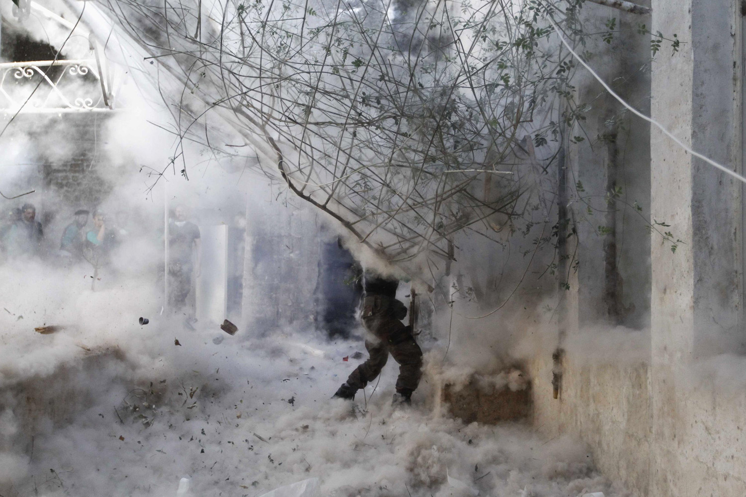 Apr. 27, 2014.  A Free Syrian Army fighter fires a rocket-propelled grenade (RPG) towards forces loyal to Syria's President Bashar al-Assad, during heavy clashes in the old city of Aleppo.