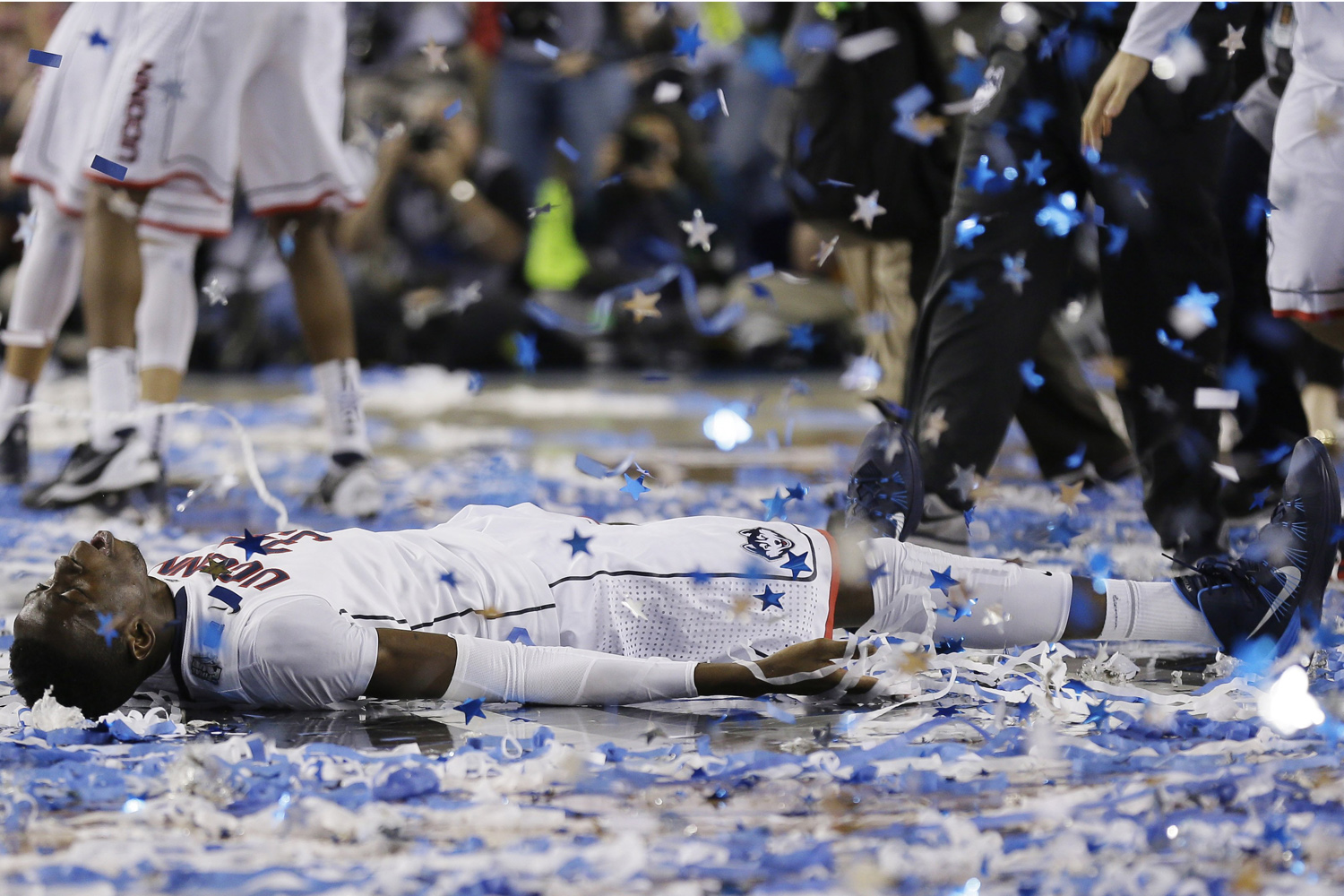 Apr. 7, 2014. Connecticut center Amida Brimah celebrates after winning the NCAA Final Four tournament college basketball championship game 60-54, against Kentucky.