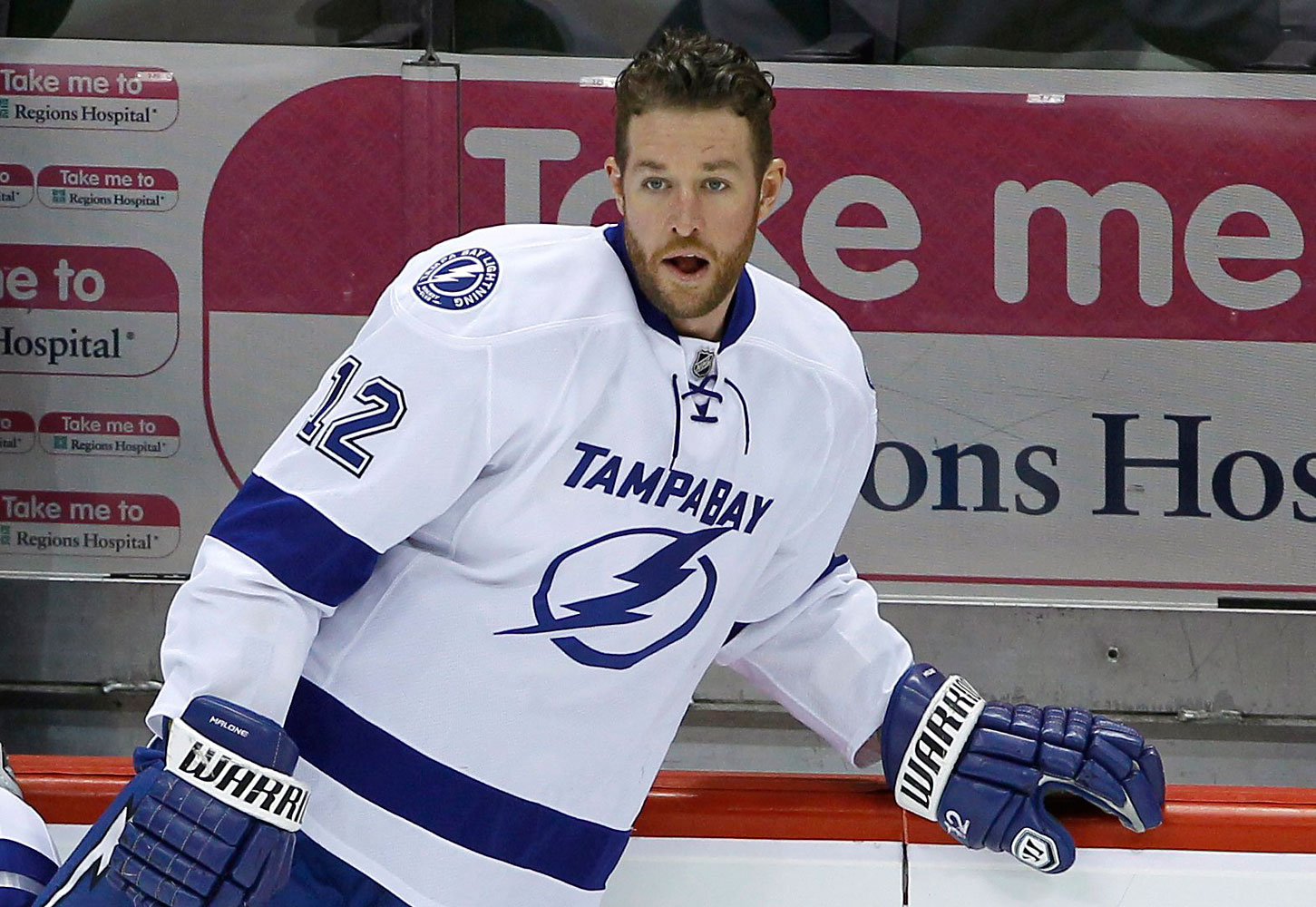 Tampa Bay Lightning left wing Ryan Malone stretches before an NHL hockey game against the Minnesota Wild in St. Paul, Minn.  Malone was charged Saturday with DUI and possession of cocaine after a traffic stop, police said.