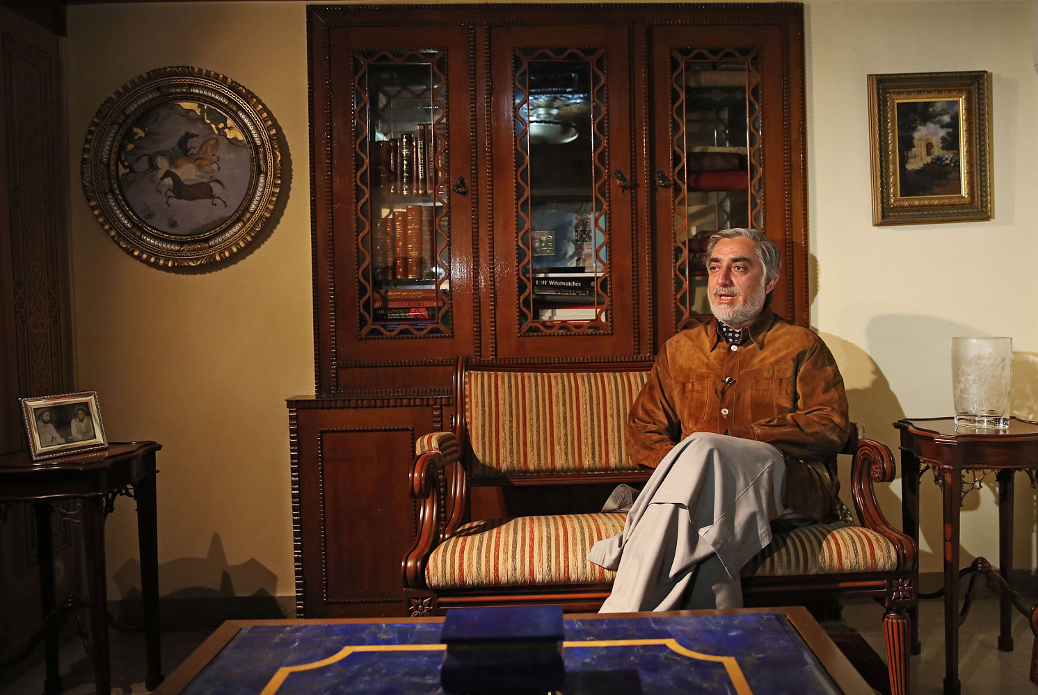 Afghan presidential candidate Abdullah Abdullah talks during an interview with the Associated Press at his residence in Kabul, Afghanistan,  April 24, 2014.