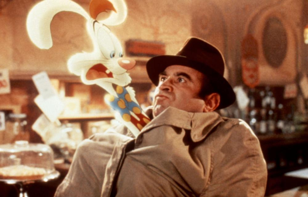 Who Framed Roger Rabbit?                               His most famous role, however, would include a rabbit. Hoskins played Eddie Valliant, an alcoholic detective with a grudge against toons, in the groundbreaking film Who Framed Roger Rabbit?. The film would go on to win four Academy Awards.