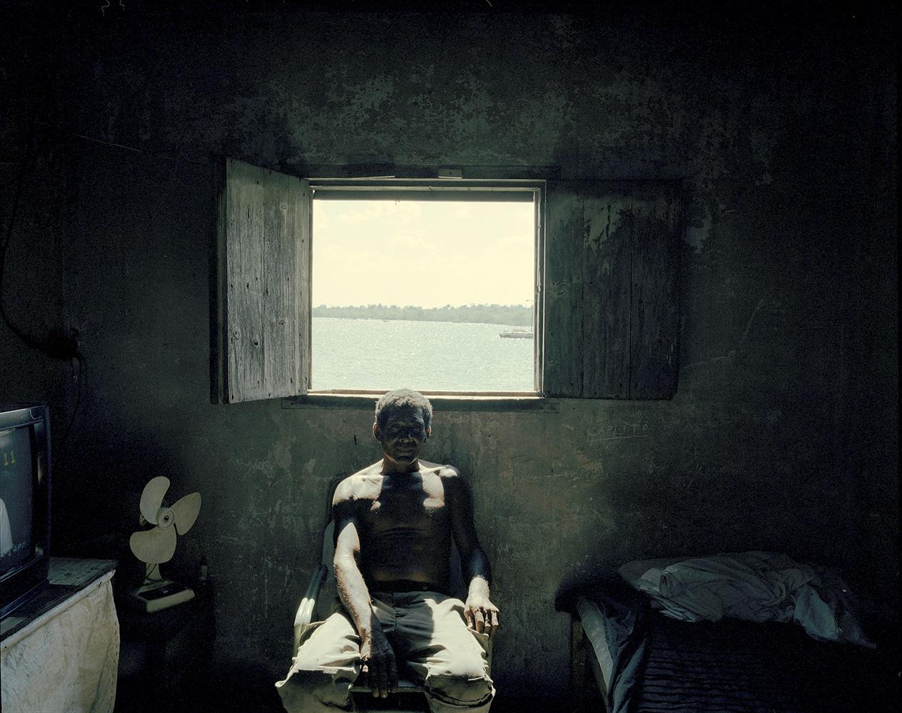 A fisherman takes a break inside his house in El Puerto de Manati, on the northeastern coast of Cuba.