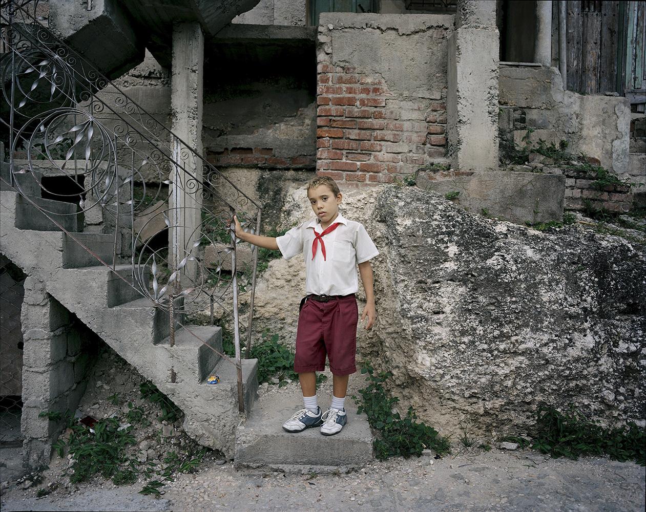 A boy gets ready to go to school in Santiago de Cuba city.