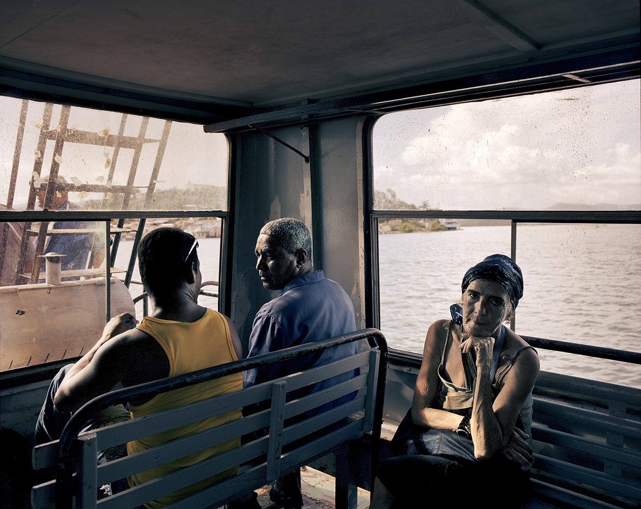 Commuters take the ferry every hour from the southern coast of Santiago de Cuba to El Cayo inlet.