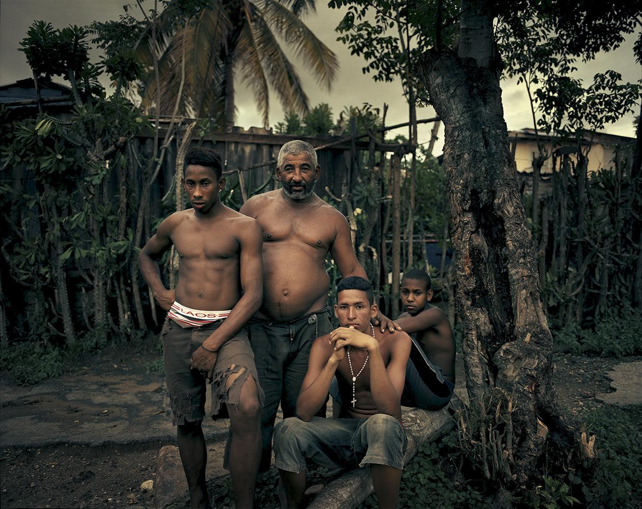 Farmers in El Brujo, a town 12 kilometers outside Santiago de Cuba, rest after working the fields.