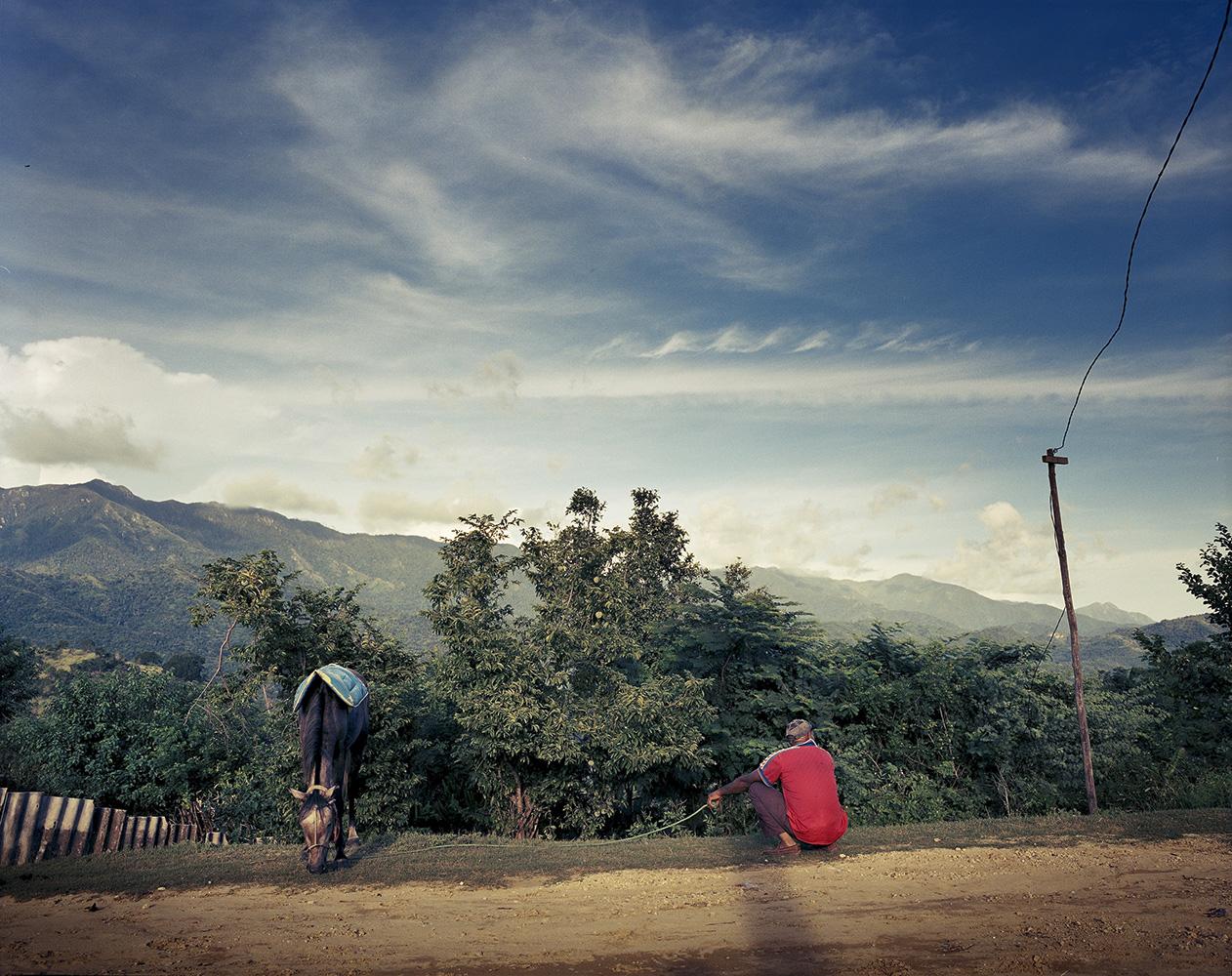 A man looks after his lambs on Siboney road, outside Santiago de Cuba.
