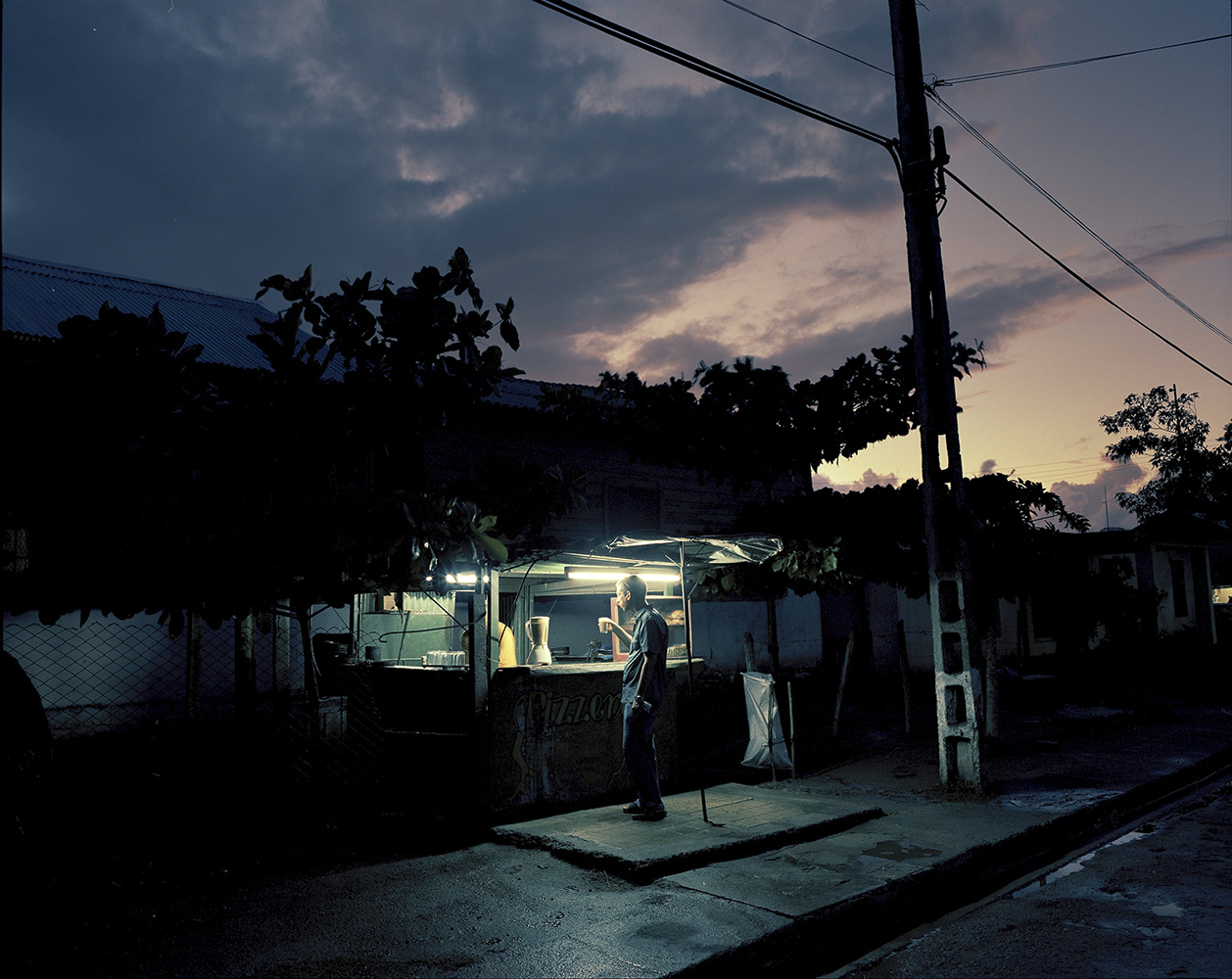 Private cafeteria at dusk in Manati town, some 460 miles east of Havana. You can find guava juice and home-made pizzas there all night long.