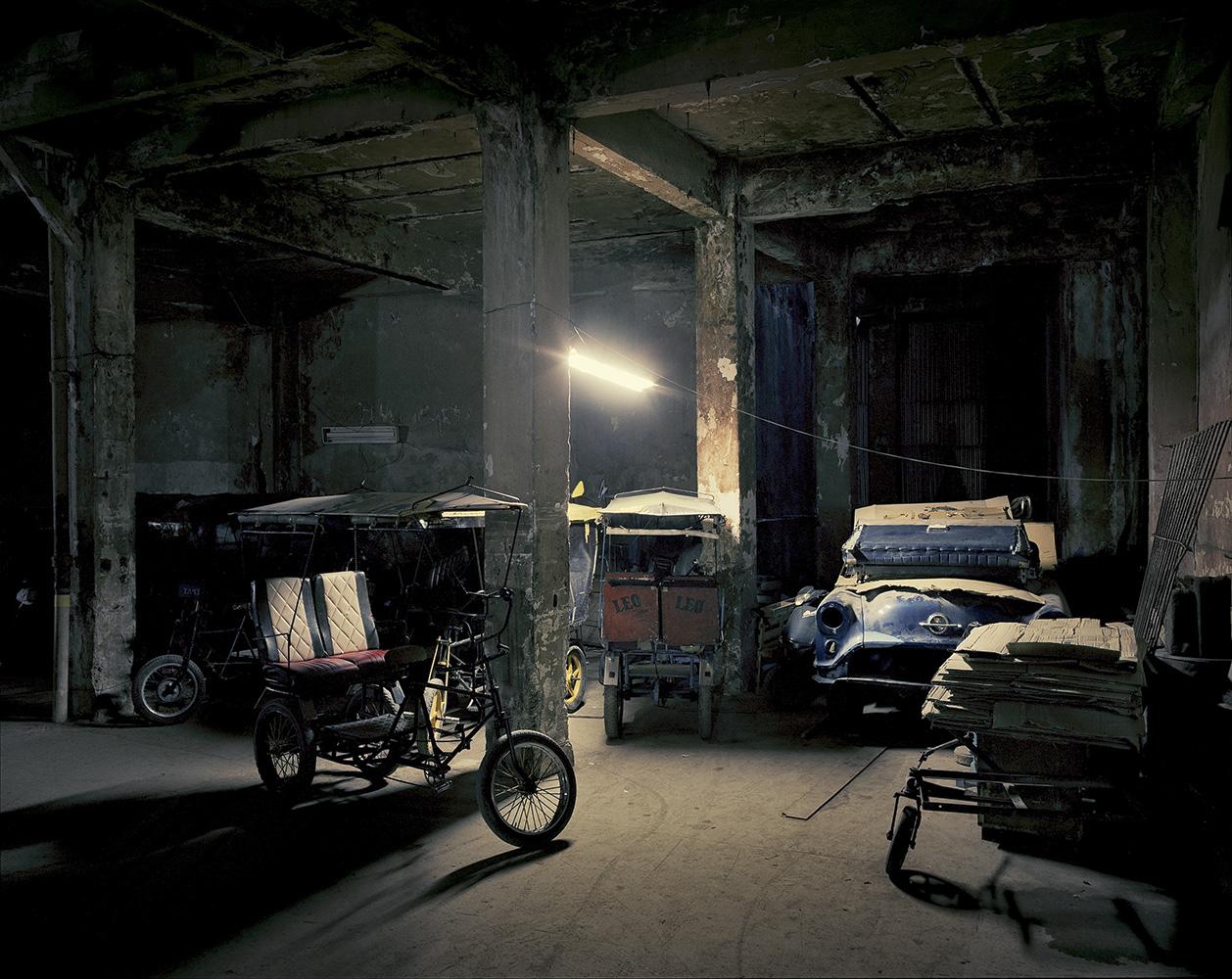 A parking lot inside a rundown building in Old Havana.