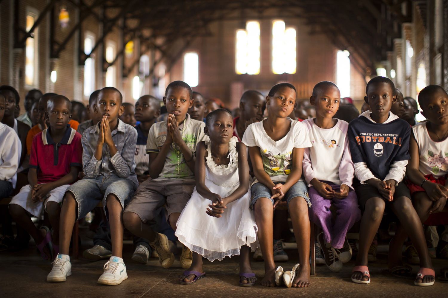 Apr. 6, 2014. Rwandan children listen and pray during a Sunday morning service at the Saint-Famille Catholic church, the scene of many killings during the 1994 genocide, in the capital Kigali, Rwanda.