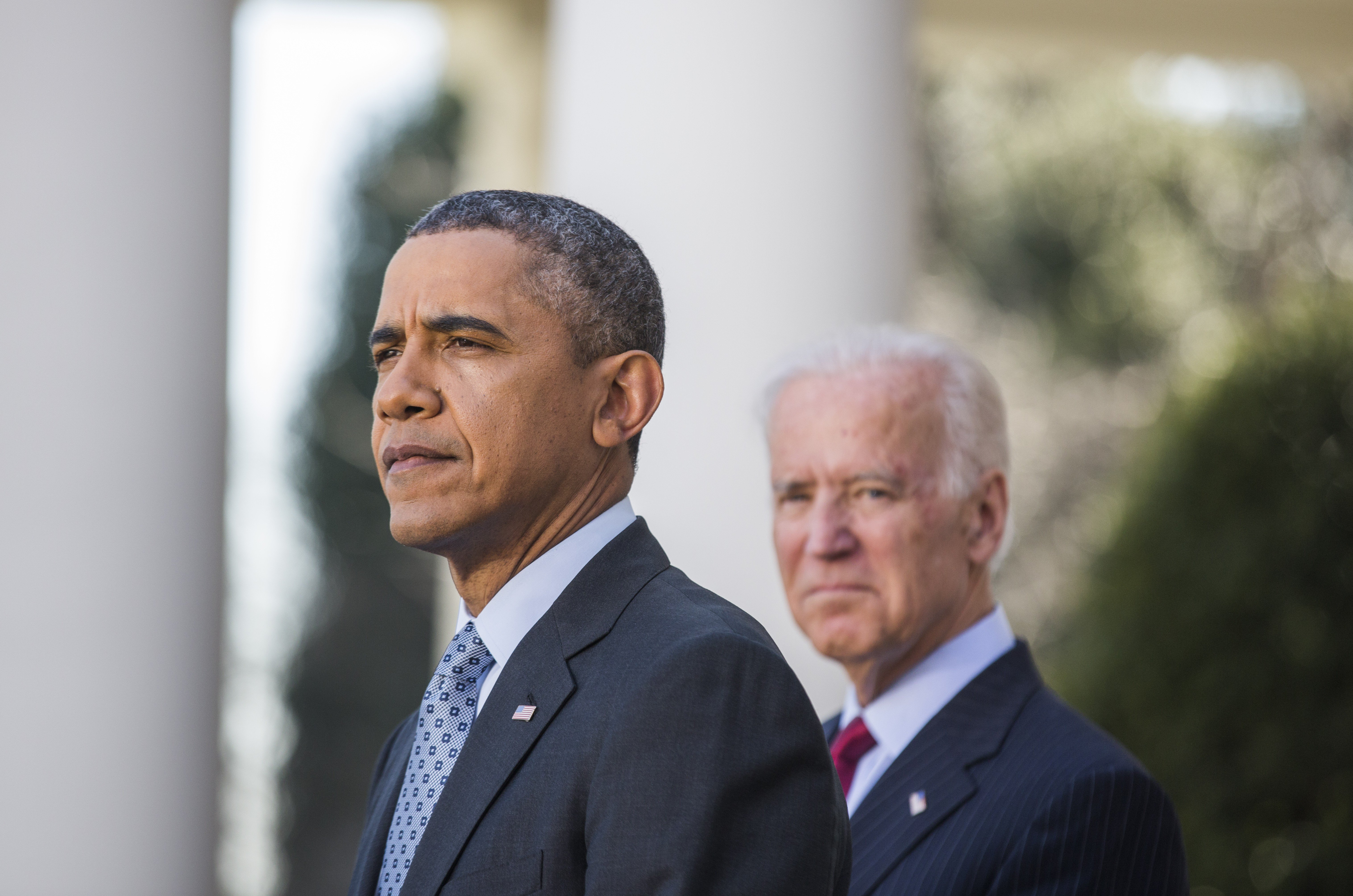 President Barack Obama, with Vice President Joe Biden, speaks about the Affordable Care Act in the Rose Garden.