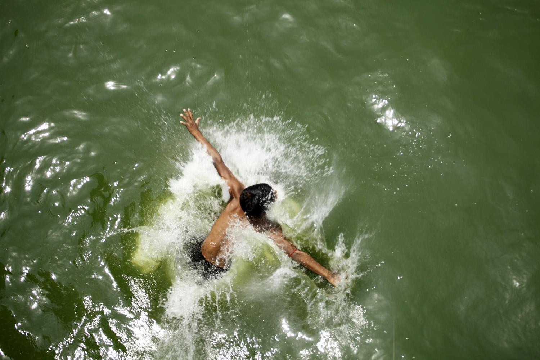 Children enjoy the Hatirjheel Lake during the hot summer weather in Dhaka, Bangladesh, on April 22, 2014.