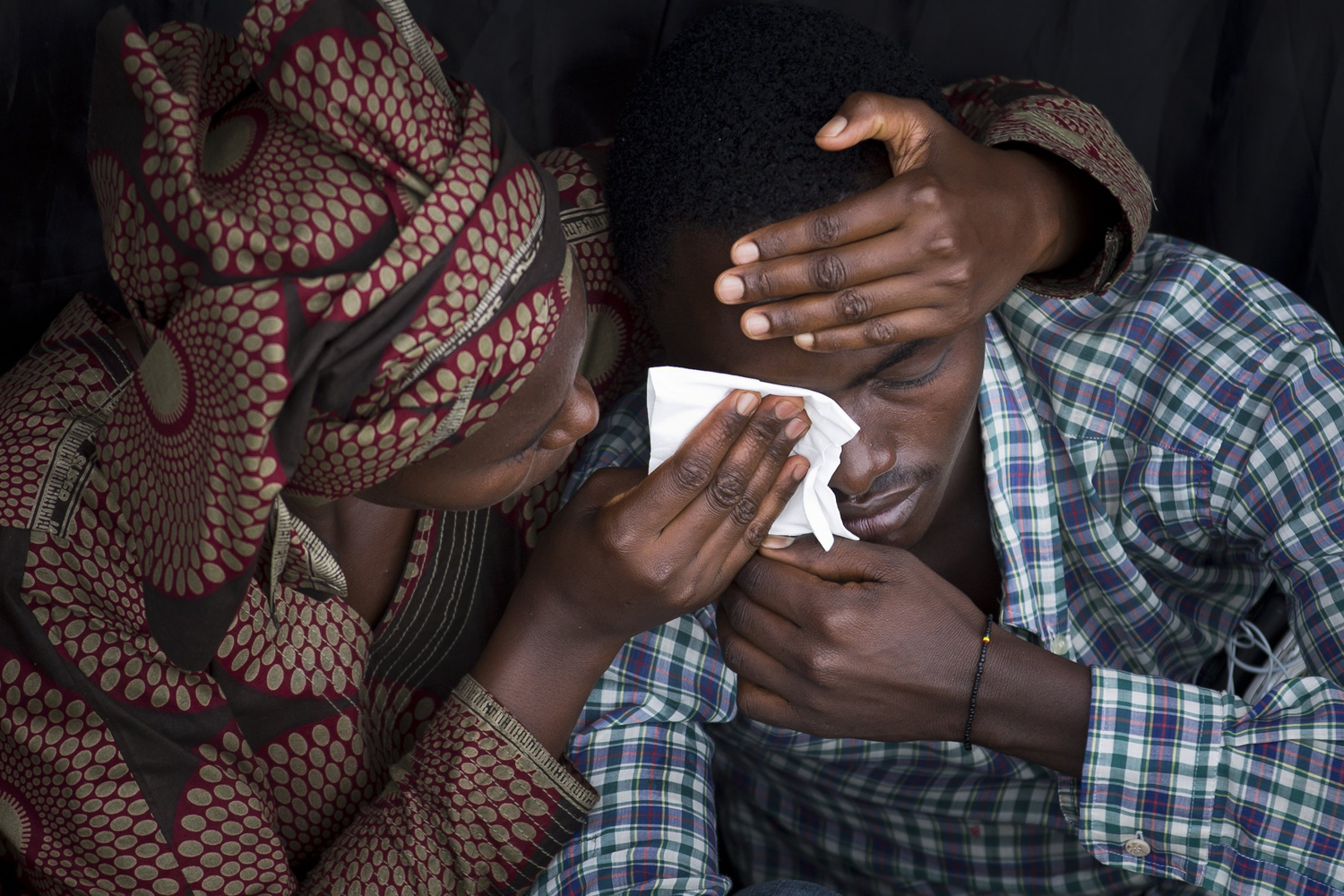 Apr. 7, 2014. Bizimana Emmanuel, who was born two years before the genocide, is consoled by an unidentified woman while attending a public ceremony to mark the 20th anniversary of the Rwandan genocide, at Amahoro stadium in Kigali, Rwanda.