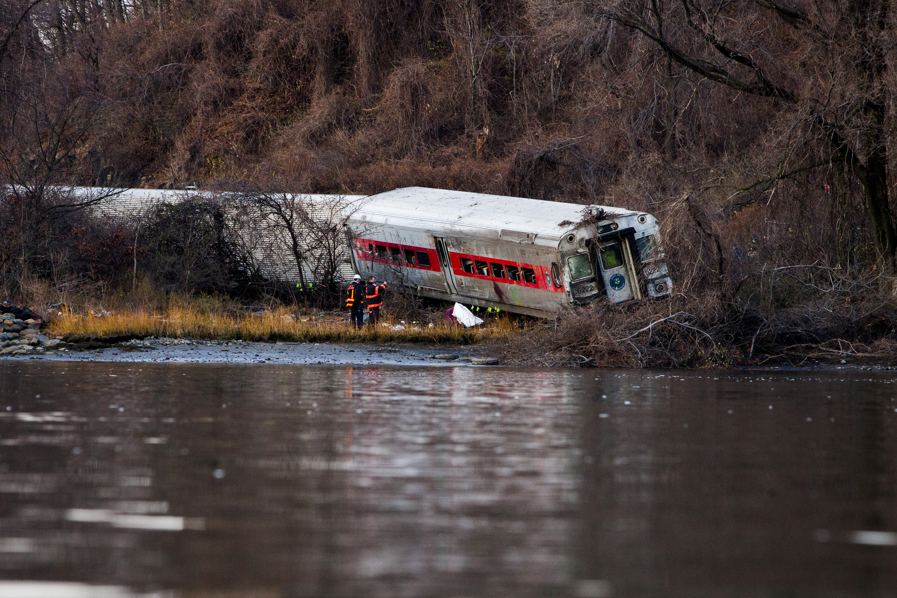 The wreckage of a Metro-North commuter train lies on its side after it derailed just north of the Spuyten Duyvil station December 1, 2013 in the Bronx, New York City.